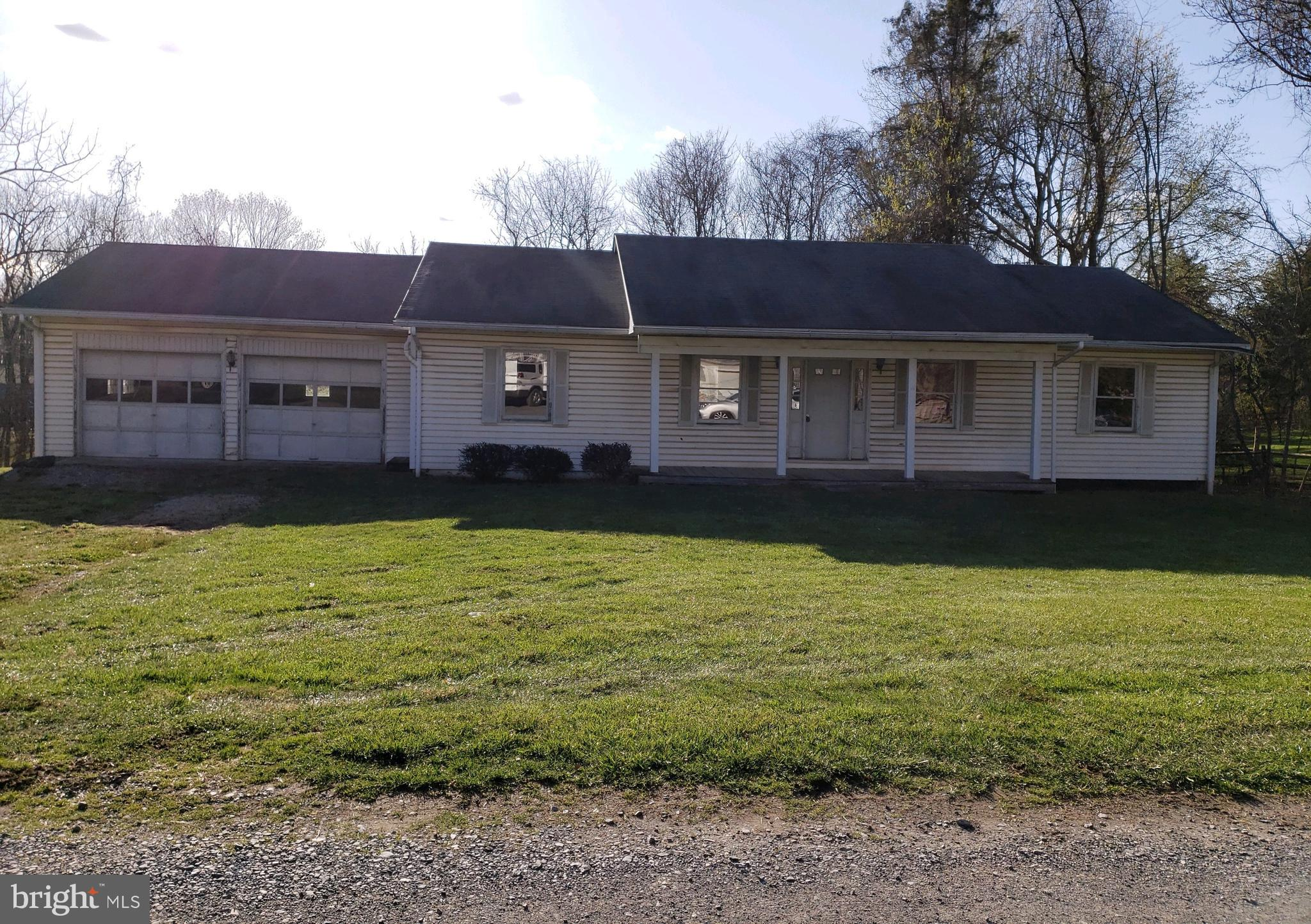 Rancher located in Blue Ridge Acres on a corner lot, 2 bedrooms, 2 bathrooms, full unfinished baseme