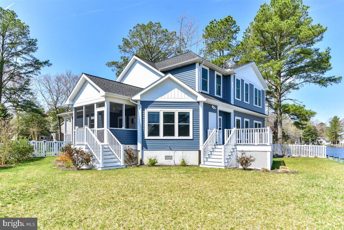 Remarkable 'almost new' construction waterfront home, situated on an oversized corner lot, with view