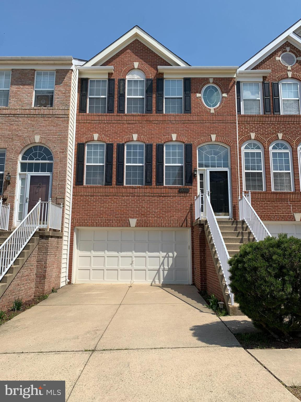 Gorgeous Lake Views from the Front and Back of this Ashburn Village stunning Brick-Front Townhouse.