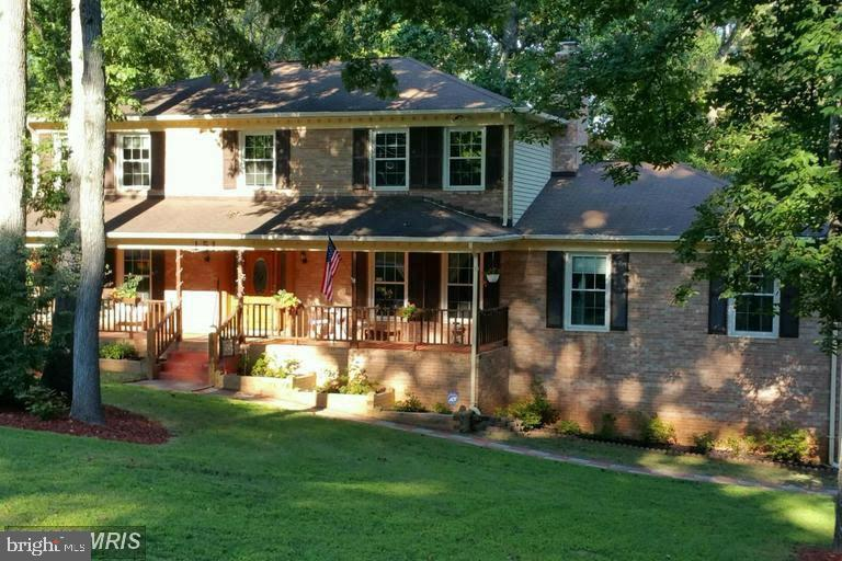 Over one acre *** Corner Lot*** Country Wrap around Porch***Walkout to a Large Fenced back Yard****