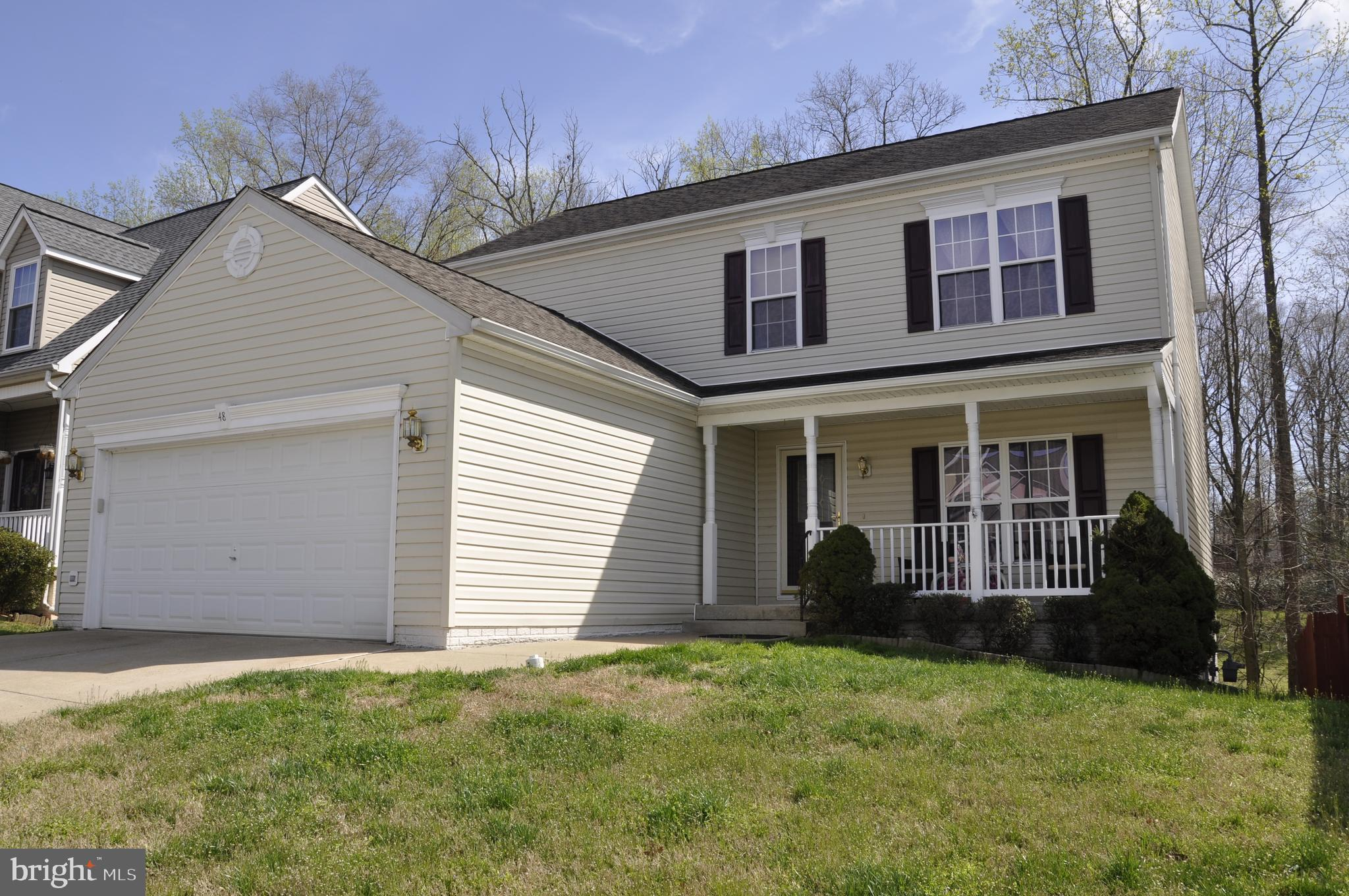 Stunning colonial single family home with 4 bedrooms, 2 full bath, and 1 half bath. Upgraded kitchen
