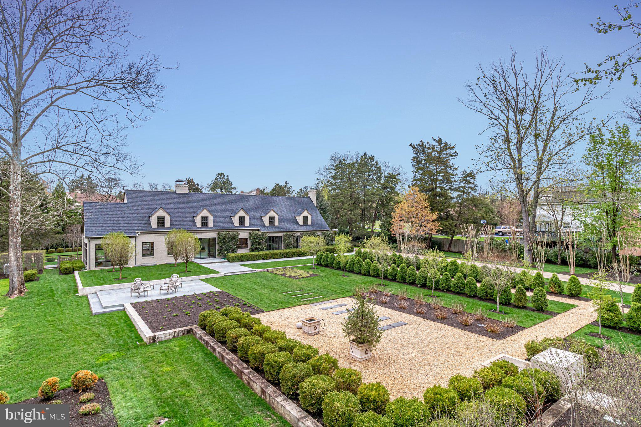Pristine, private & meticulously maintained SFH with curated grounds & gardens designed by Katia Gof