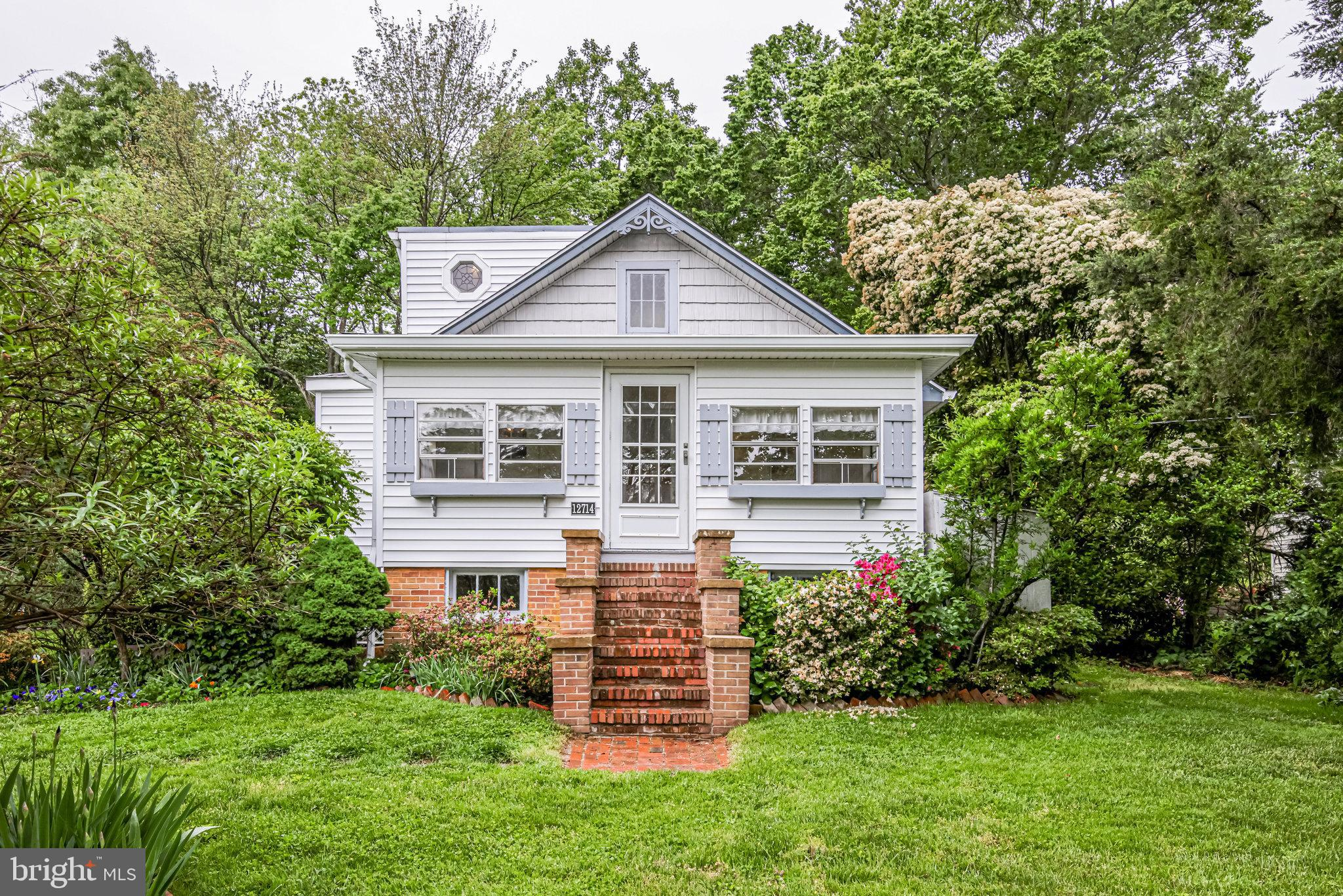 ***This charming home will win your heart as soon as you drive up the driveway onto the property! Th