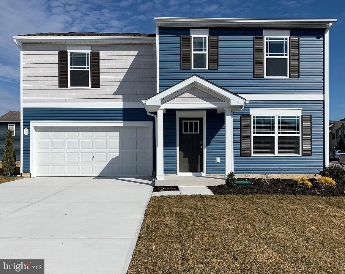 Available, move in ready new construction home in the Cedar Commons community that will be complete