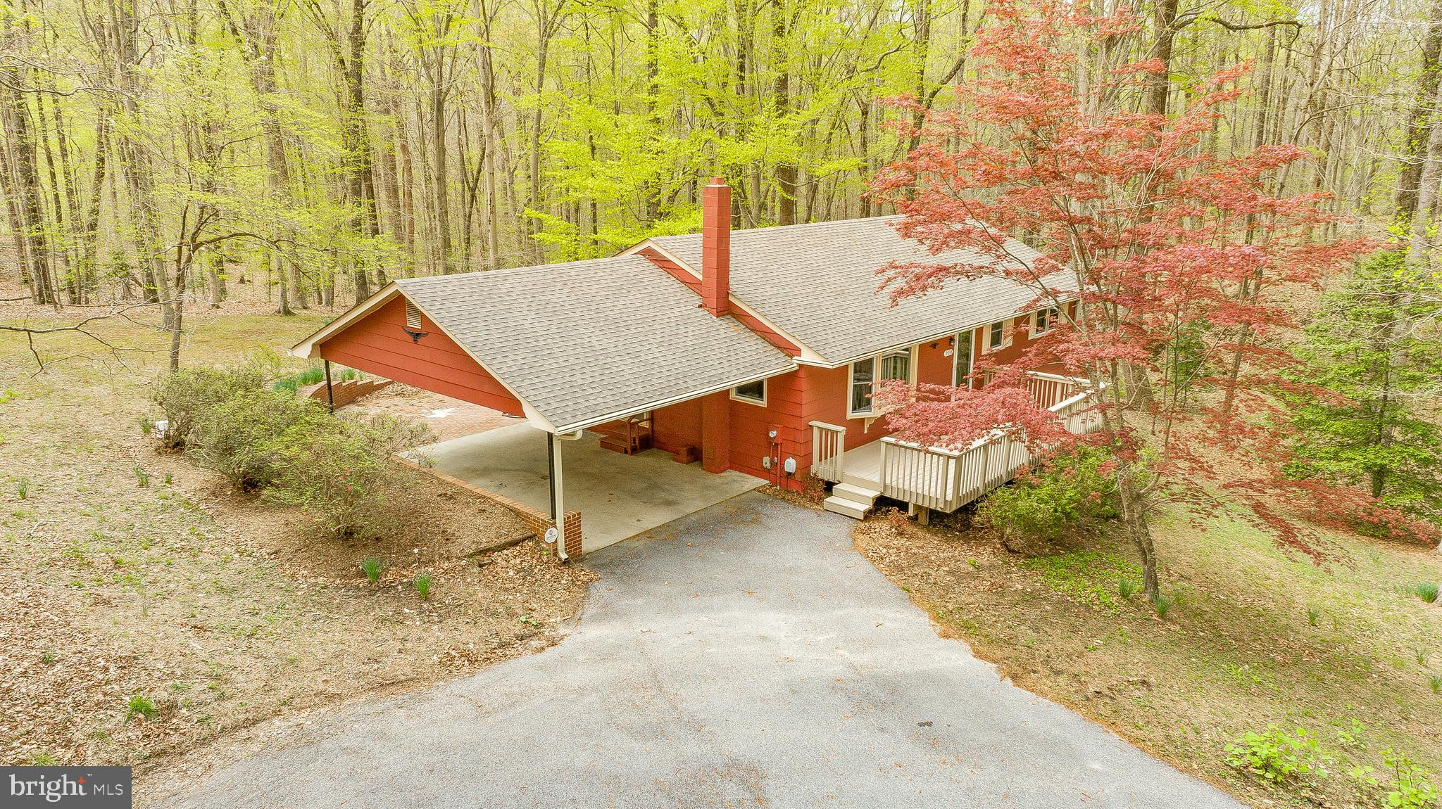 Immaculate 3 bed, 2.5 bath rambler on 3.7 acres of privacy in sought after Dunkirk Woods.  This home