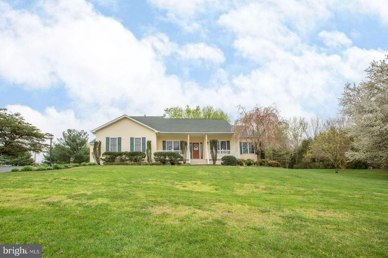 """**MULTIPLE OFFERS RECEIVED, HIGHEST AND BEST OFFERS DUE 05/18/2020 5PM** Price reduced! This meticulously maintained home is ready for new owners! There is so much storage! The kitchen has a huge island (with an electrical outlet) with tons of storage,  an area where you can place stools, eat-in area with plantation shutters, stainless steel appliances, 5 burner stove, granite countertops,  42"""" cabinets & the cabinets with the glass doors have interior lights, hardwood floors, separate dining room with chair railing, formal living room or office, family room with gas fireplace (with remote), the master bedroom has a huge walk-in closet & plantation shutters, master bathroom has a huge soaking tub,  a separate shower, dual sinks and you can even install a TV above the sink area( already pre-wired)!  There is a huge front porch and 20'x40' ( 600 SQFT mostly) covered deck!  There is a swing set and horse shoe pit in the back yard, stamped concrete patio in addition to several fruit trees, including green apple tree, grapes, and blackberries ! The second attached garage is actually a boat house with an eight foot opening and is 31' x 15' and  can be used as a second 2 car garage! There is an exit door in the front and back for easy access, you can even build a 2nd story on the boathouse or use the attic for even more storage!  The crawl space has been encapsulated as well as the attic.  The windows, HVAC & roof are about 5 years old; the shingles are 50 year mold proof,  septic pumps are new, there is a humidifier on the HVAC that is about 5-7 years old with an infrared bacteria zapper that cleans the air for allergies  and so much more! The community has water access, that boats with trolling motors can be used (No gas motors), picnic tables and the reservoir is fully stocked if you like to fish! There is a 9 zone irrigation system. The main bathroom on the main level has handicap access for the shower."""