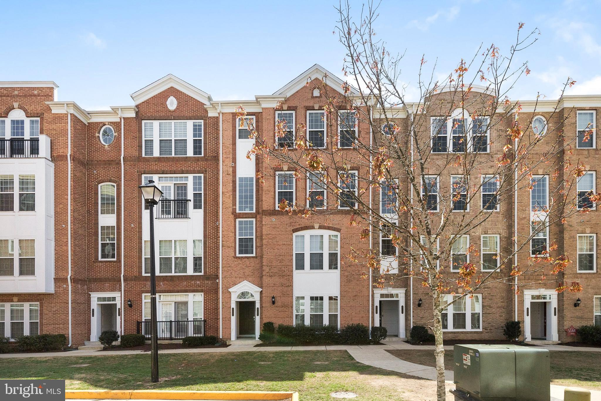 Upper level brick townhouse-style condo, looks like a model home. Move-in condition. With new paint,