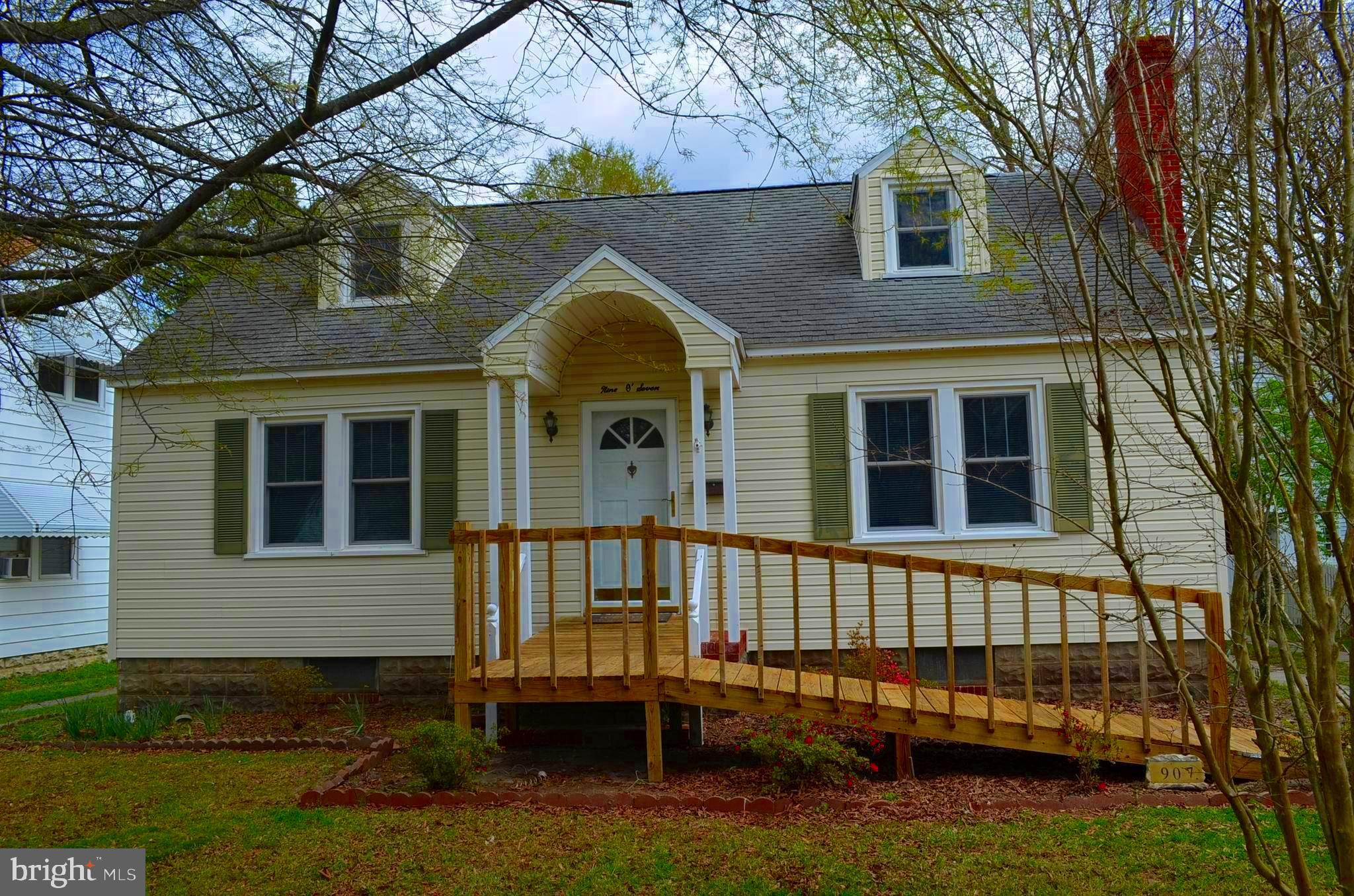 This Affordable 4 Bedroom 1772 sq ft Cape with beautiful wood floors, sunroom/great room & brick flo