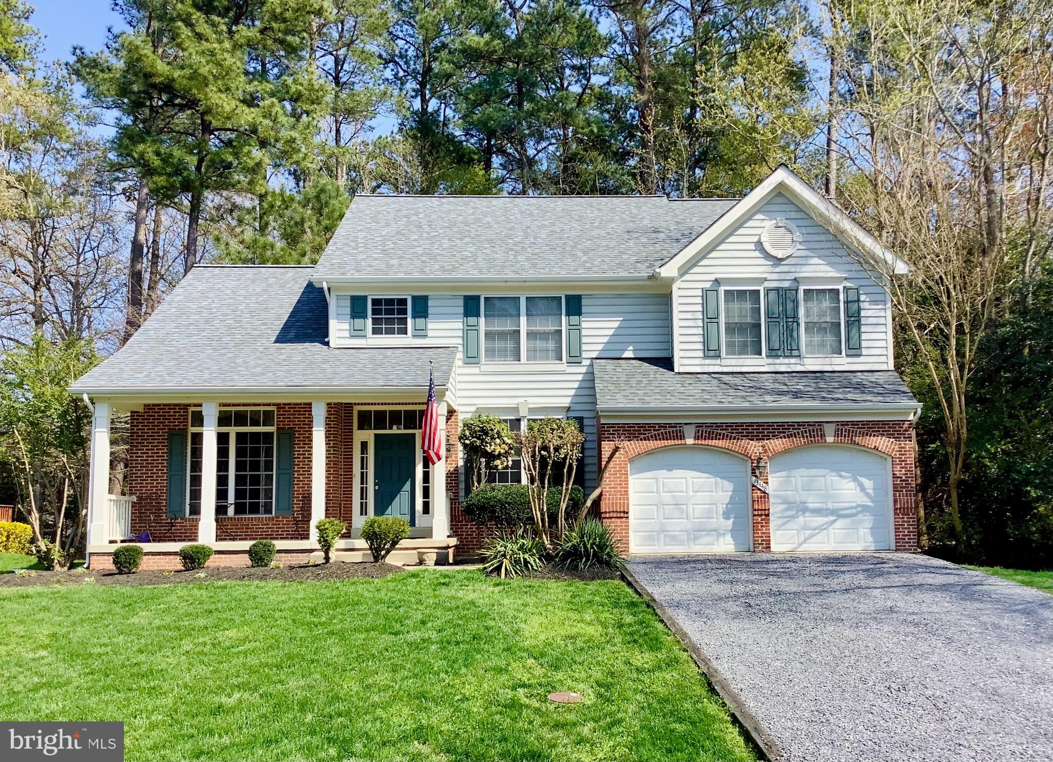Welcome home to Harbor Point! Charming 4 bedroom 2 1/2 bath colonial is nestled back to the wooded a
