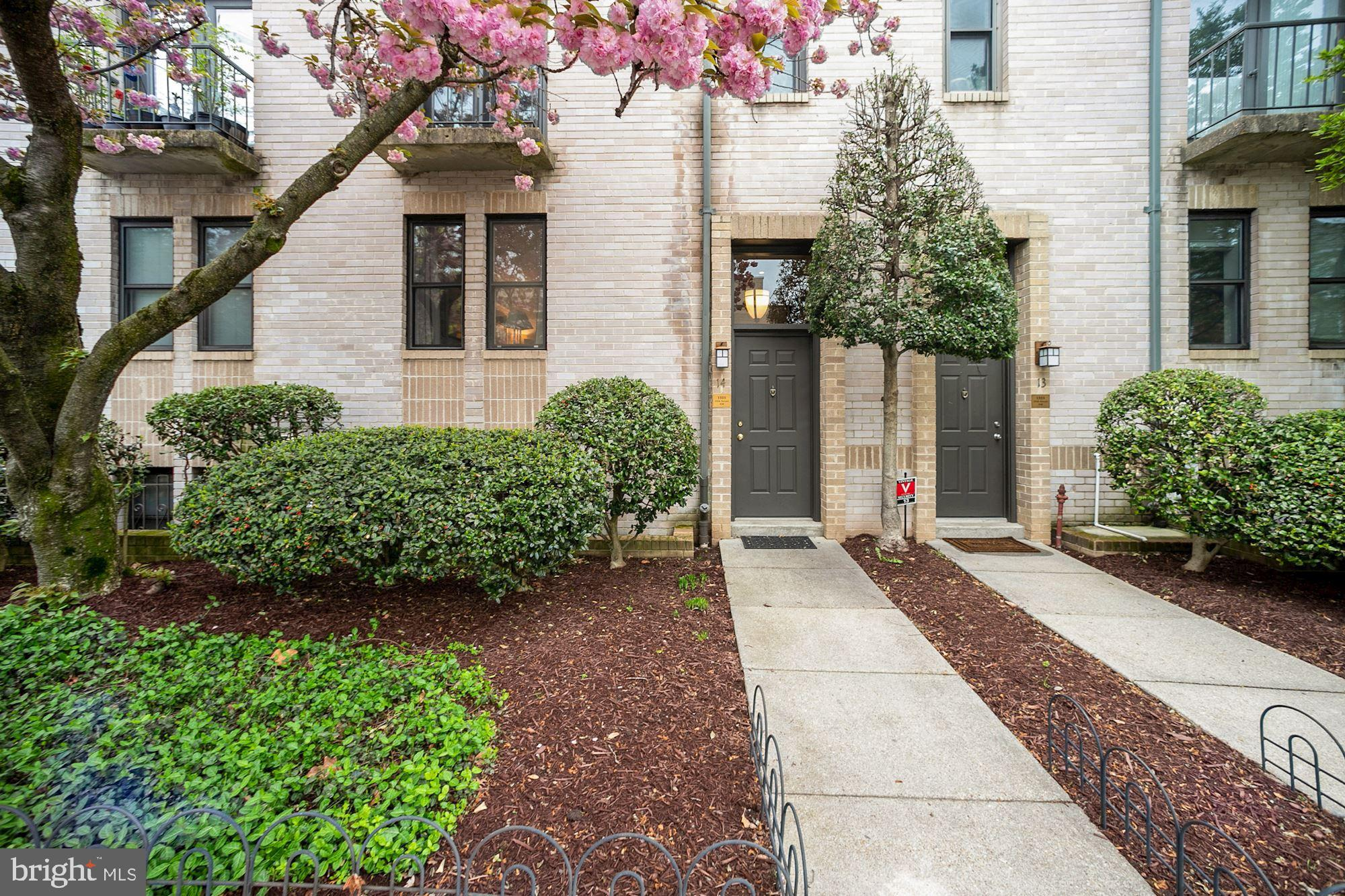 Rarely available multi-level Logan Circle townhouse with private street level access to all the amen
