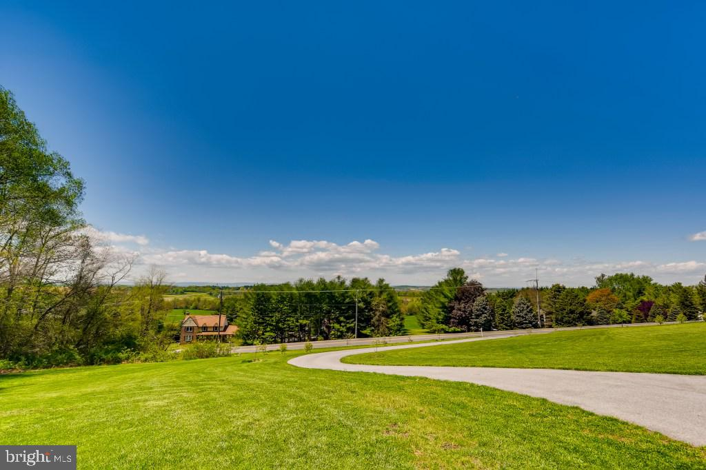 Custom Home on a large lot with spectacular views. Open floor plan, lots of natural light, farmhouse
