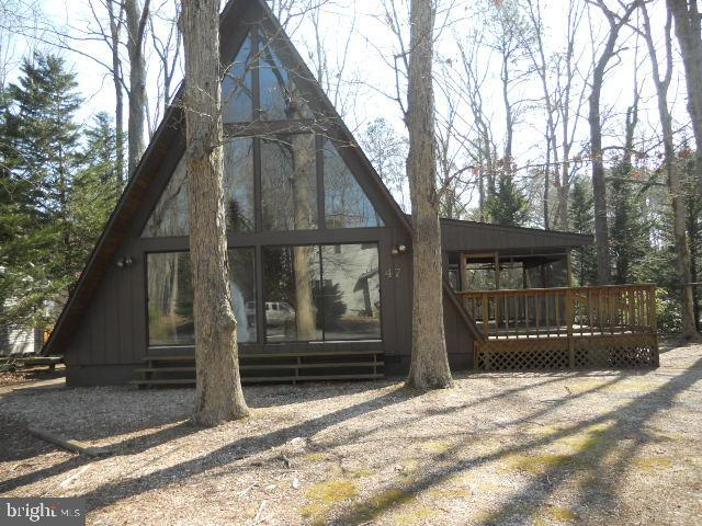 Unique home on corner lot. This A-Frame offers floor to ceiling windows, an open floor plan with sto