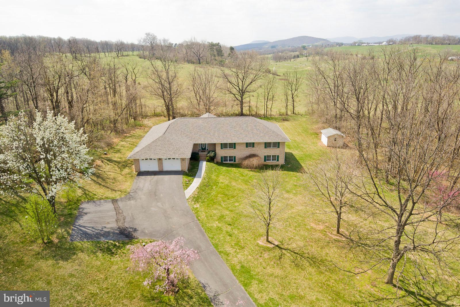 Gorgeous , large , ALL BRICK rancher on 5 acres. All hard surface roads. NEW roof,  NEW Gas Furnace