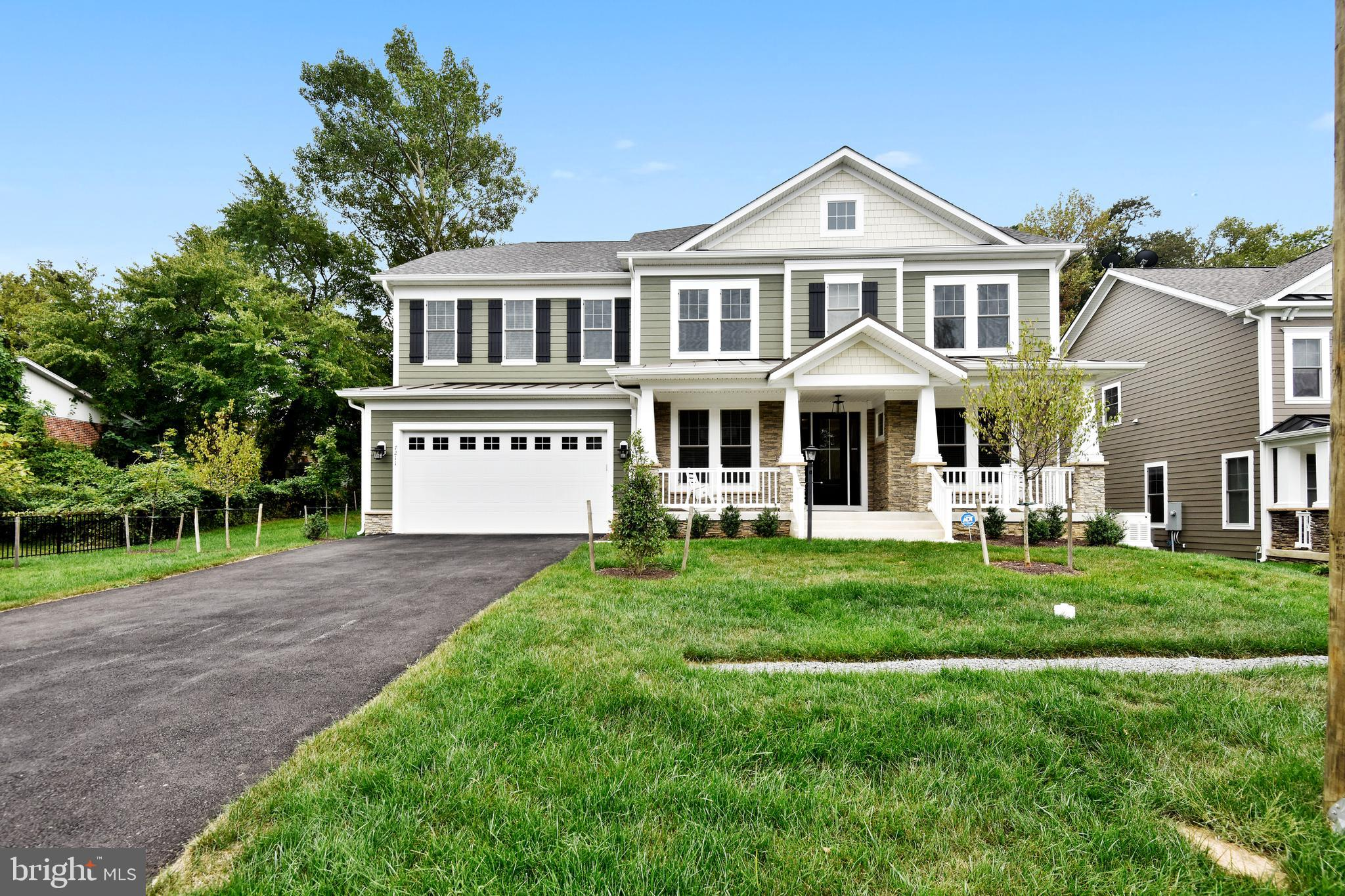 Almost NEW Craftsman style home that used to be the Custom Builder's Model Home,  in sought after ne