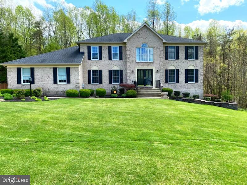 GORGEOUS single family home situated on over a half acre lot backed and sided to stunning tree views