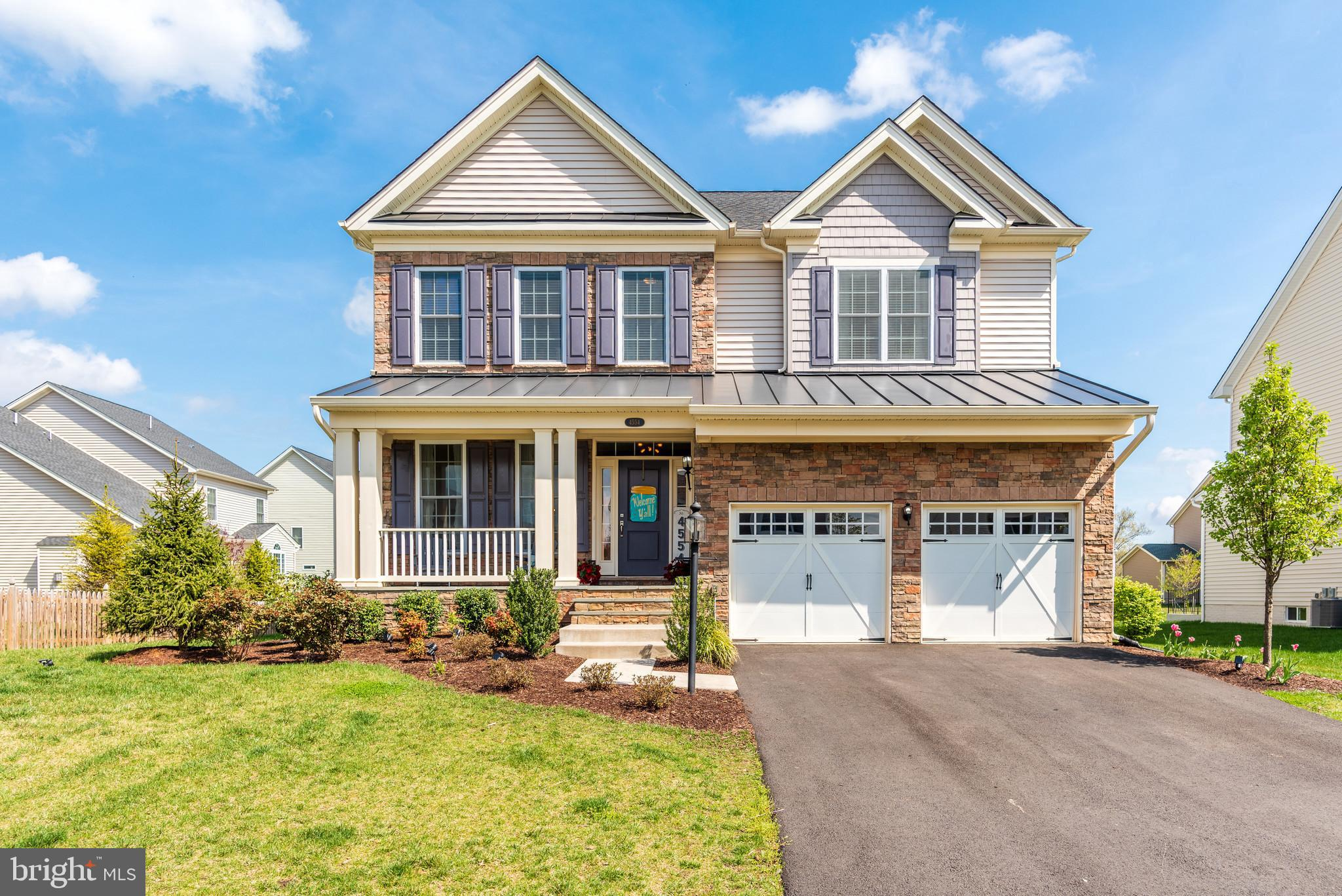 Stunning like New (2-Years Old) 4 bedroom/4.5 bath colonial in the beautiful Gated golf community of