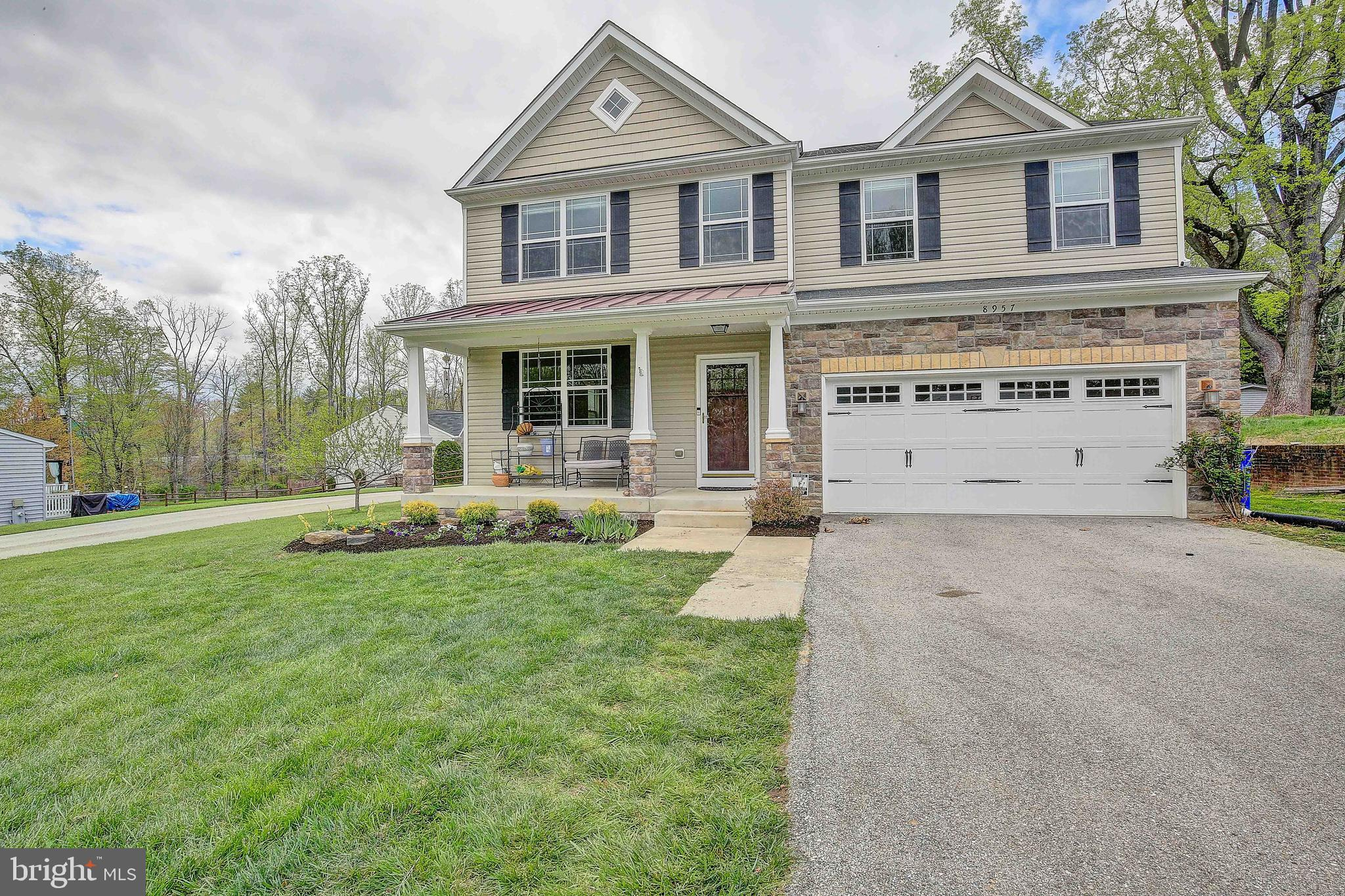 Absolutely GORGEOUS!   This home sits on a large, half acre, flat lot and has just been painted for