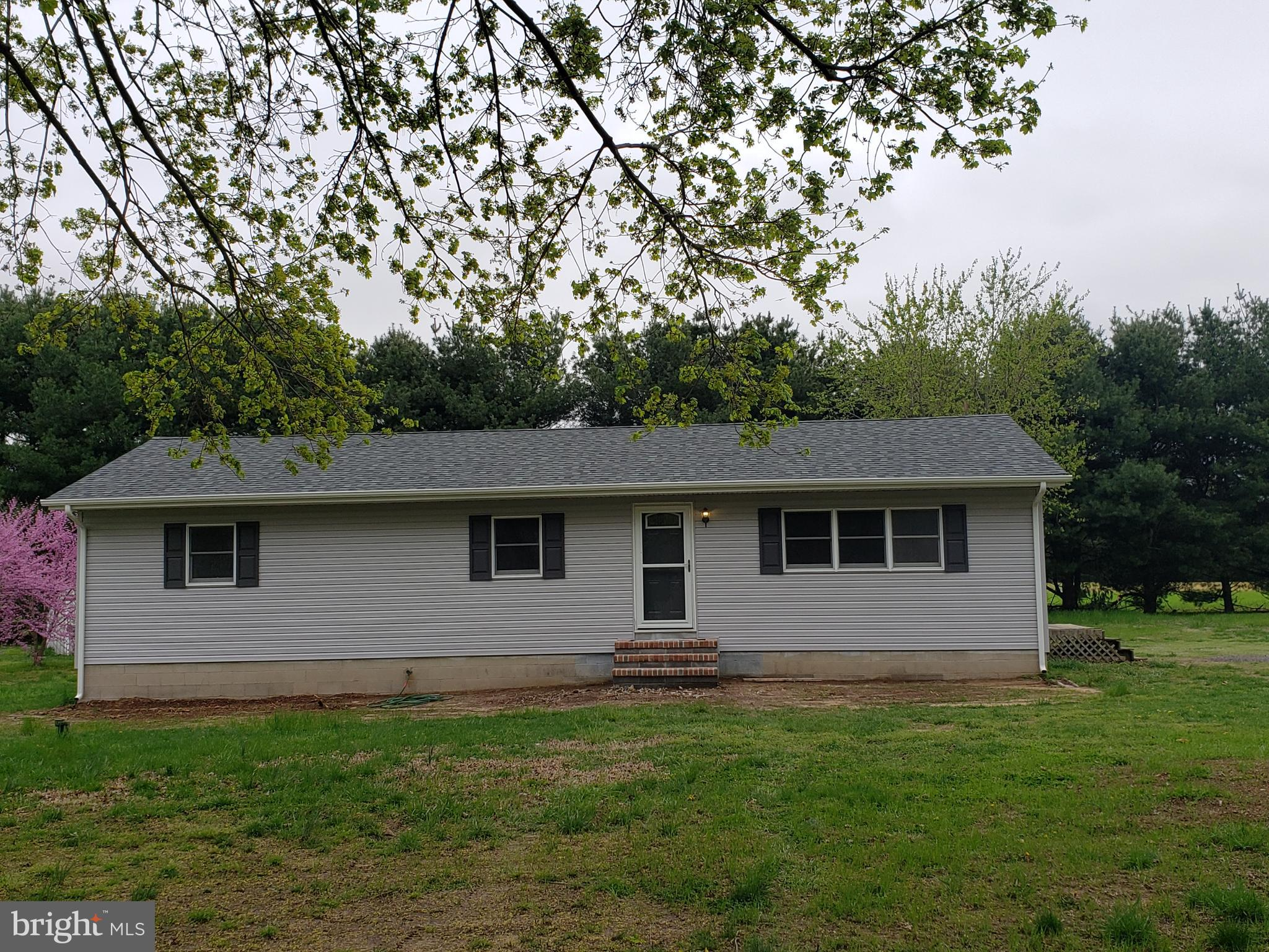 CUTE AS A BUTTON RANCHER.  REDONE TOP TO BOTTOM AND READY FOR NEW OWNERS.  GREAT LOCATION JUST ACROS