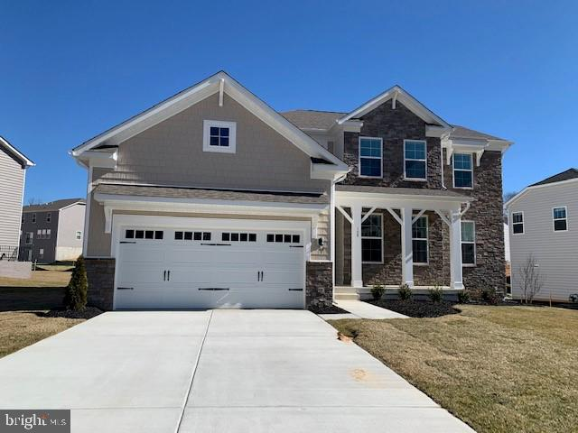 MOVE IN READY! The Edison is Shelton Knolls only first floor master plan. Stately stone exterior wit