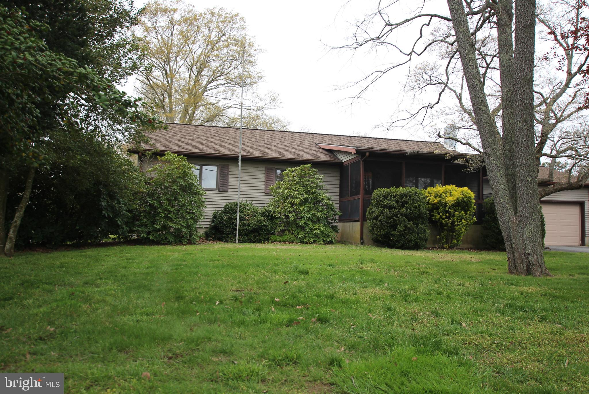 Fantastic opportunity awaits......this 3 bedroom home is located in Rehoboth on an oversized lot,  e