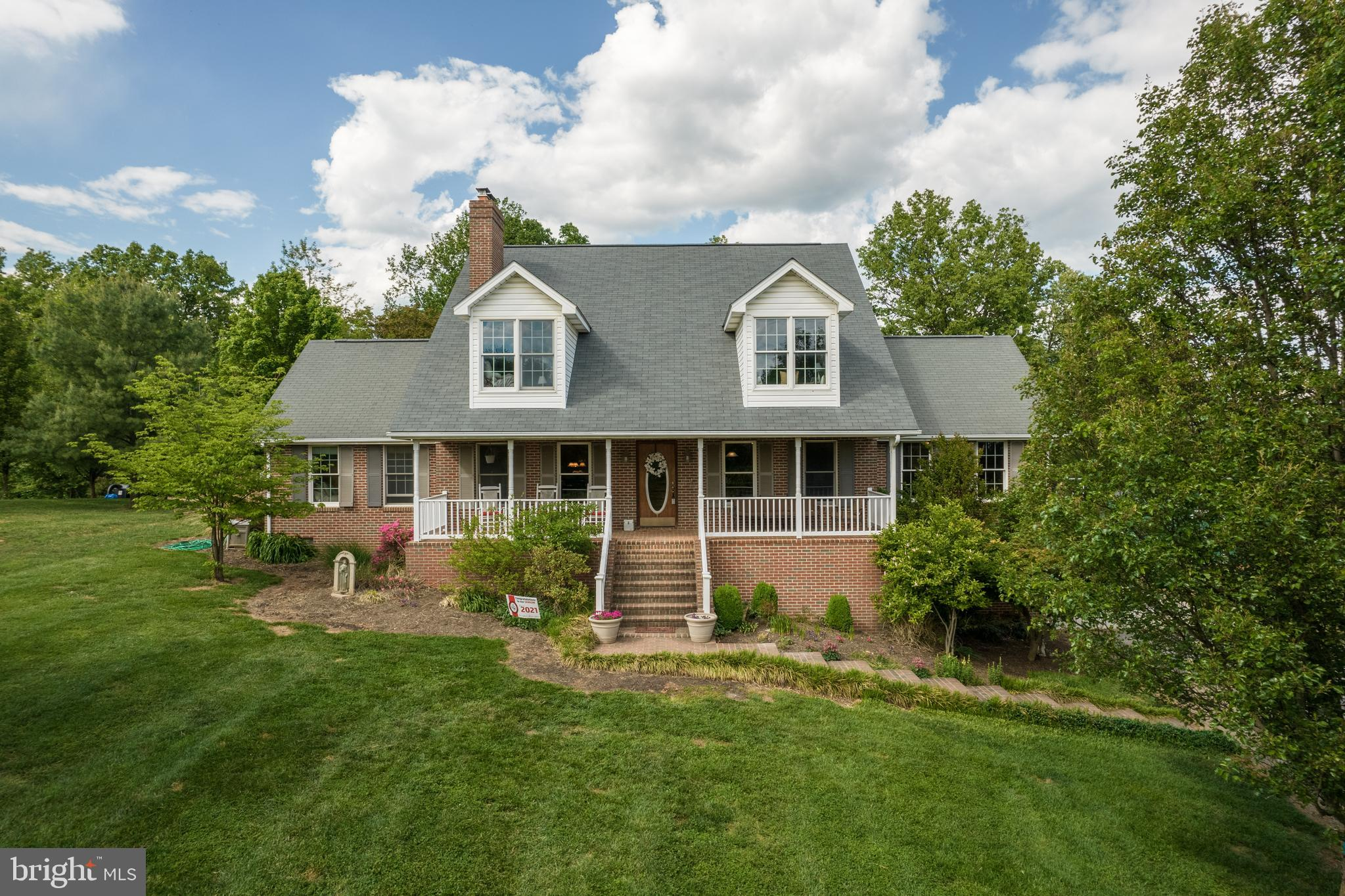 Enjoy gorgeous mountain  and orchard views from your front porch  on 2.47 acres with close proximity