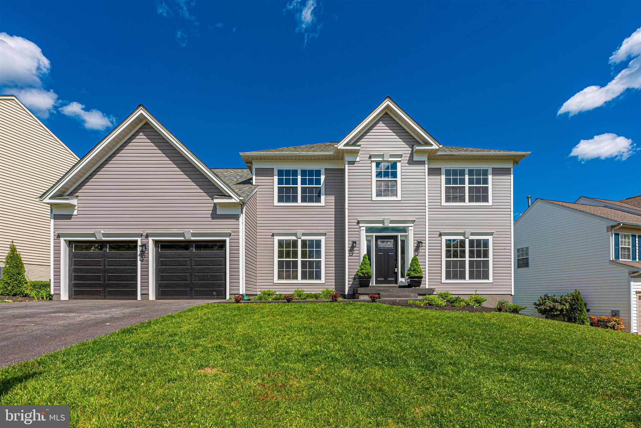Welcome home to 6317 Knollwood Drive! This absolutely stunning, fully renovated, 4 bedroom 2 1/2 bat