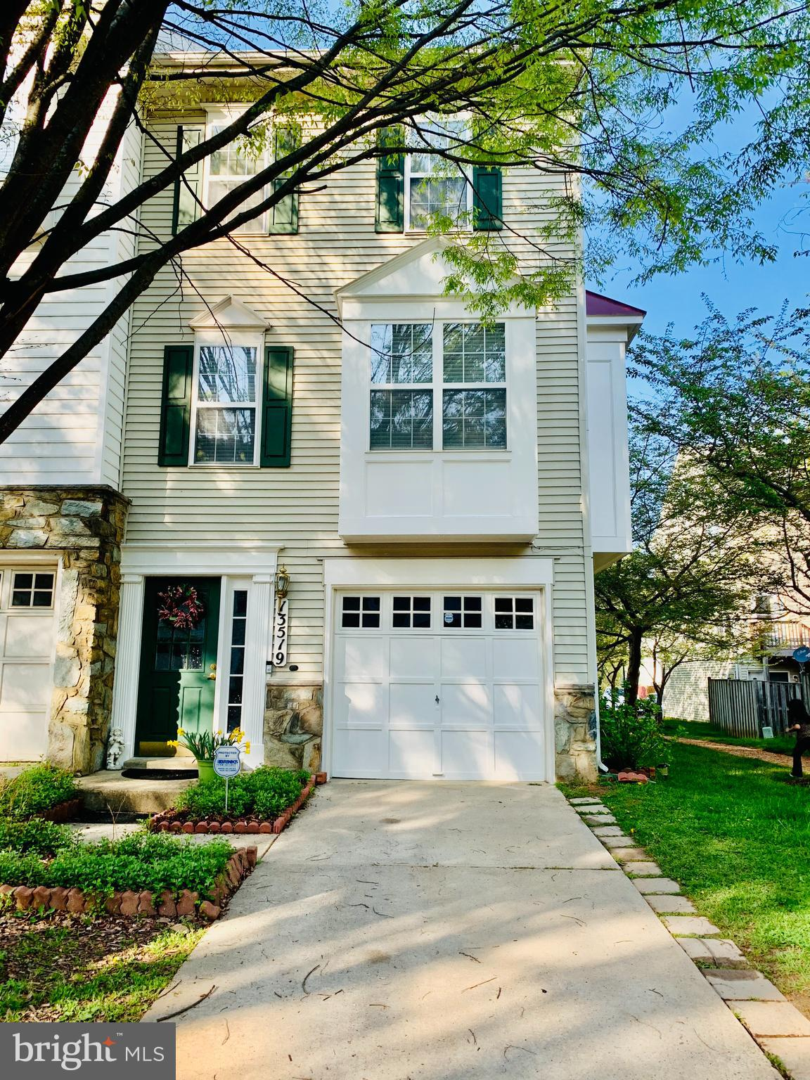 Tons of windows and sunshine throughout this spacious end unit townhome. Kitchen has granite counter