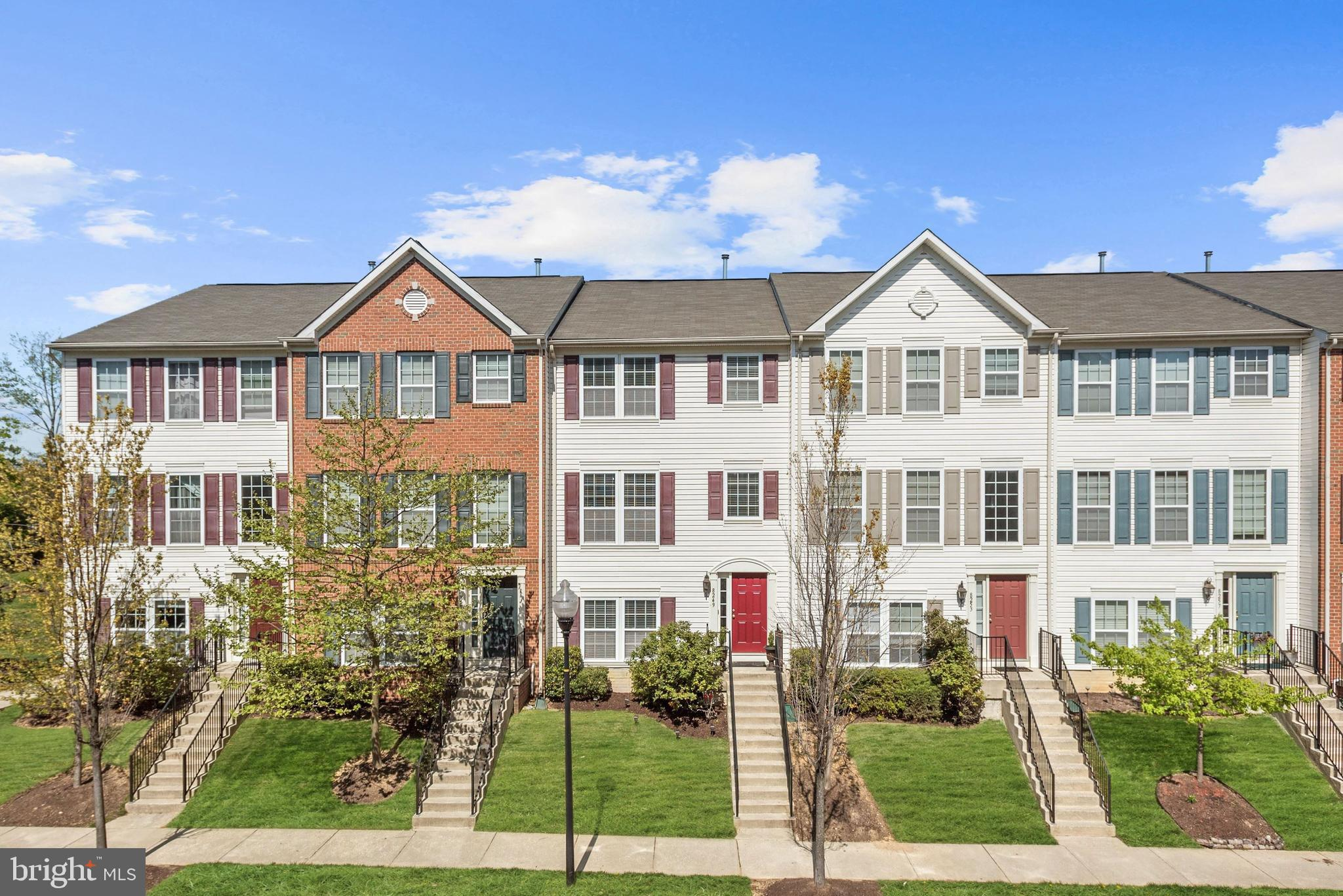 Stunning colonial townhome in the Summerfield at Mission Place community boasting gleaming floors, l