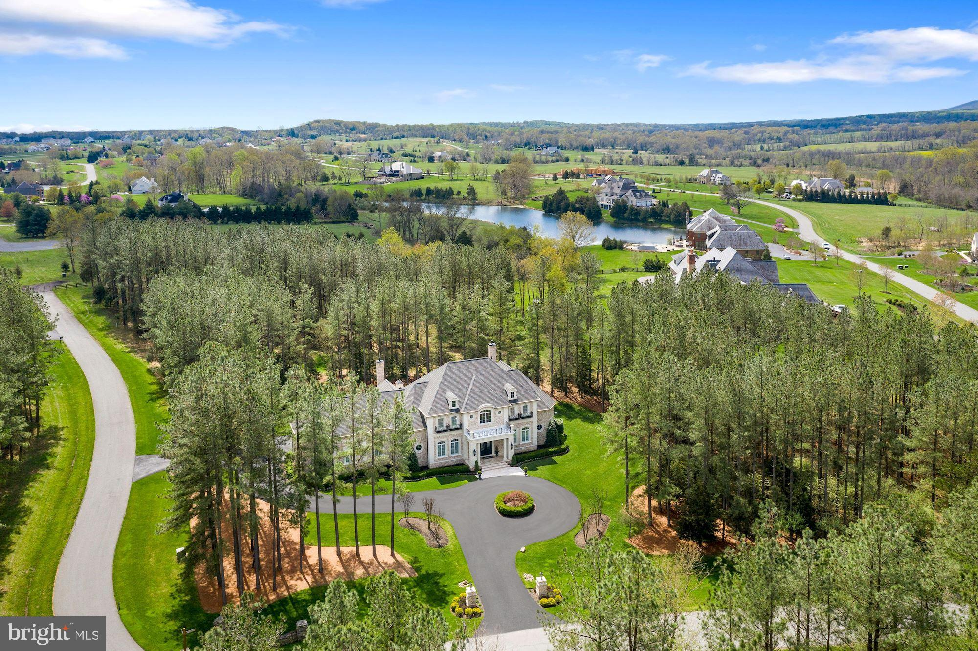 Prepare to fall in love with this spectacular custom-built home behind the gates of the private, awa