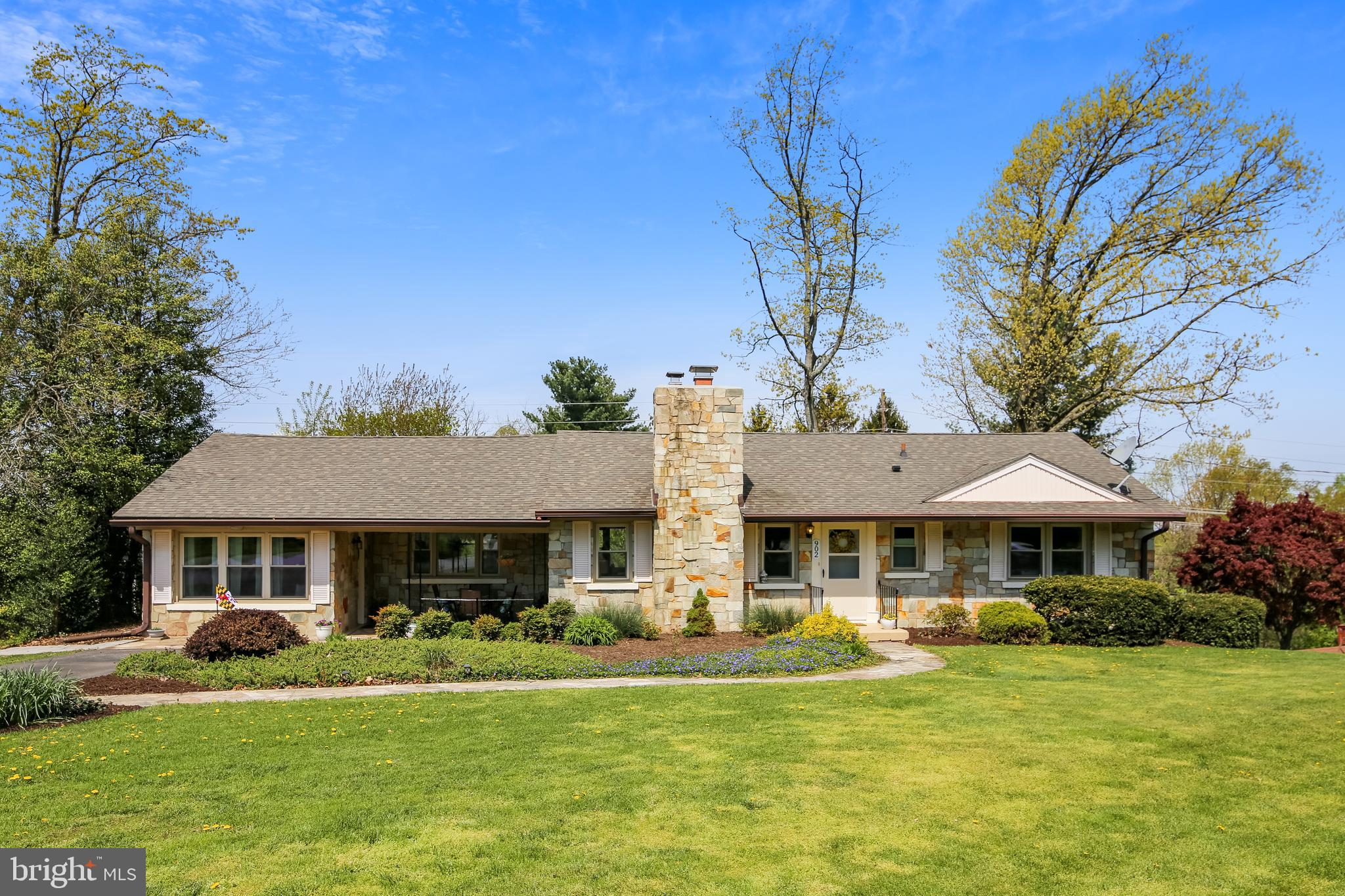 This updated stone ranch, sited on a gorgeous .72ac lot, is centrally located to downtown Mt Airy an