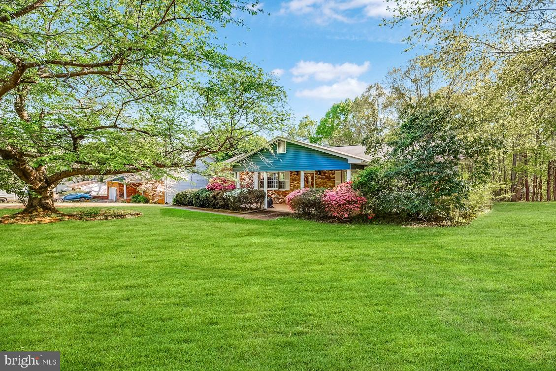 This is must-see home. Over 4,000 sqft on a 1.7-acre lot, just minutes from the marina. The main lev