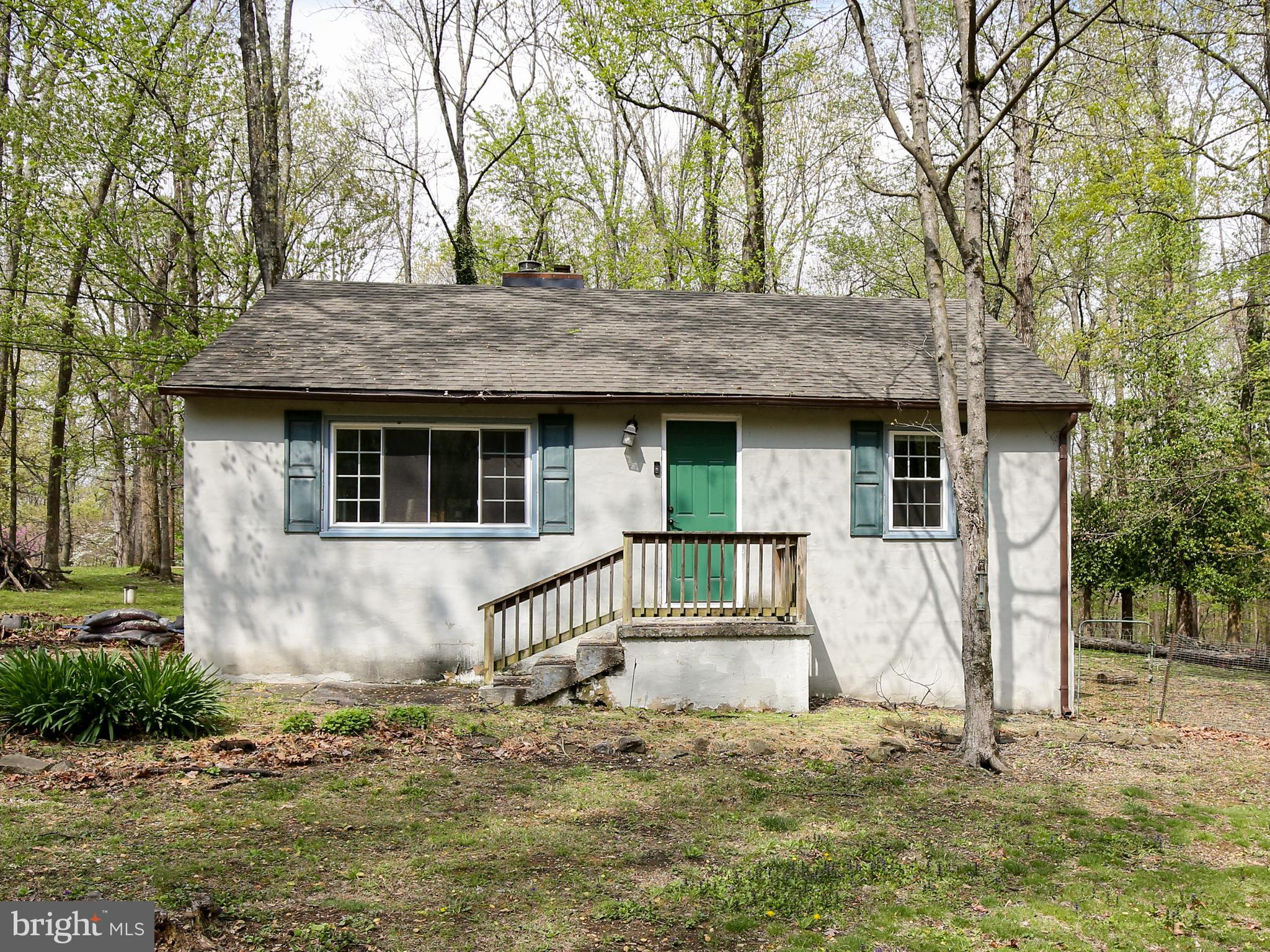 """Sold """"As-is"""".  Charming 2 bed cottage situated in beautiful Bluemont!  Property is approximately .5"""