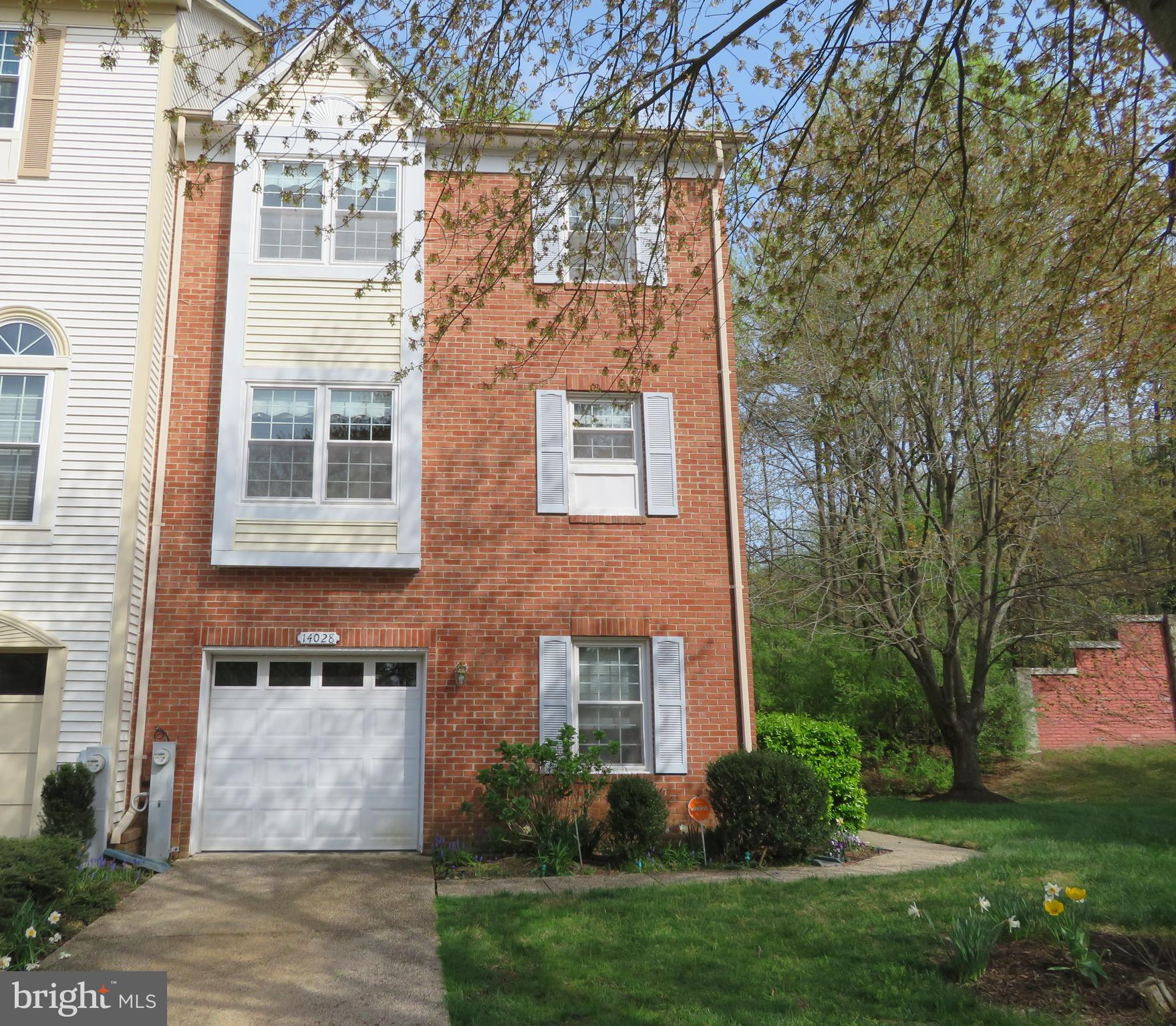 Immaculately Maintained End Unit Garage Townhome will take your breath away!  Main level entrance fe