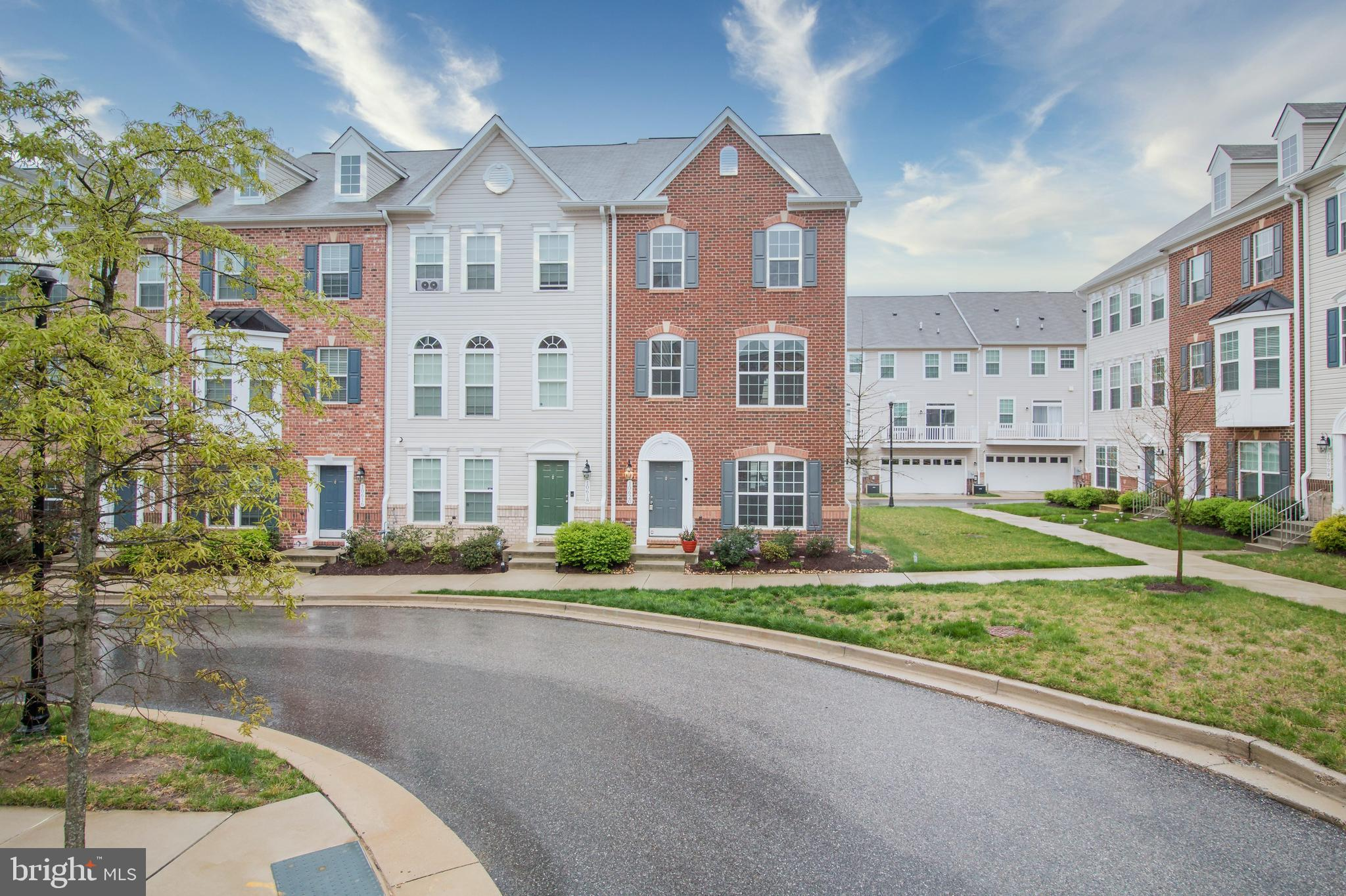 You are going to love this one!!!! This exquisite end unit townhome has it all. Barely a few years o