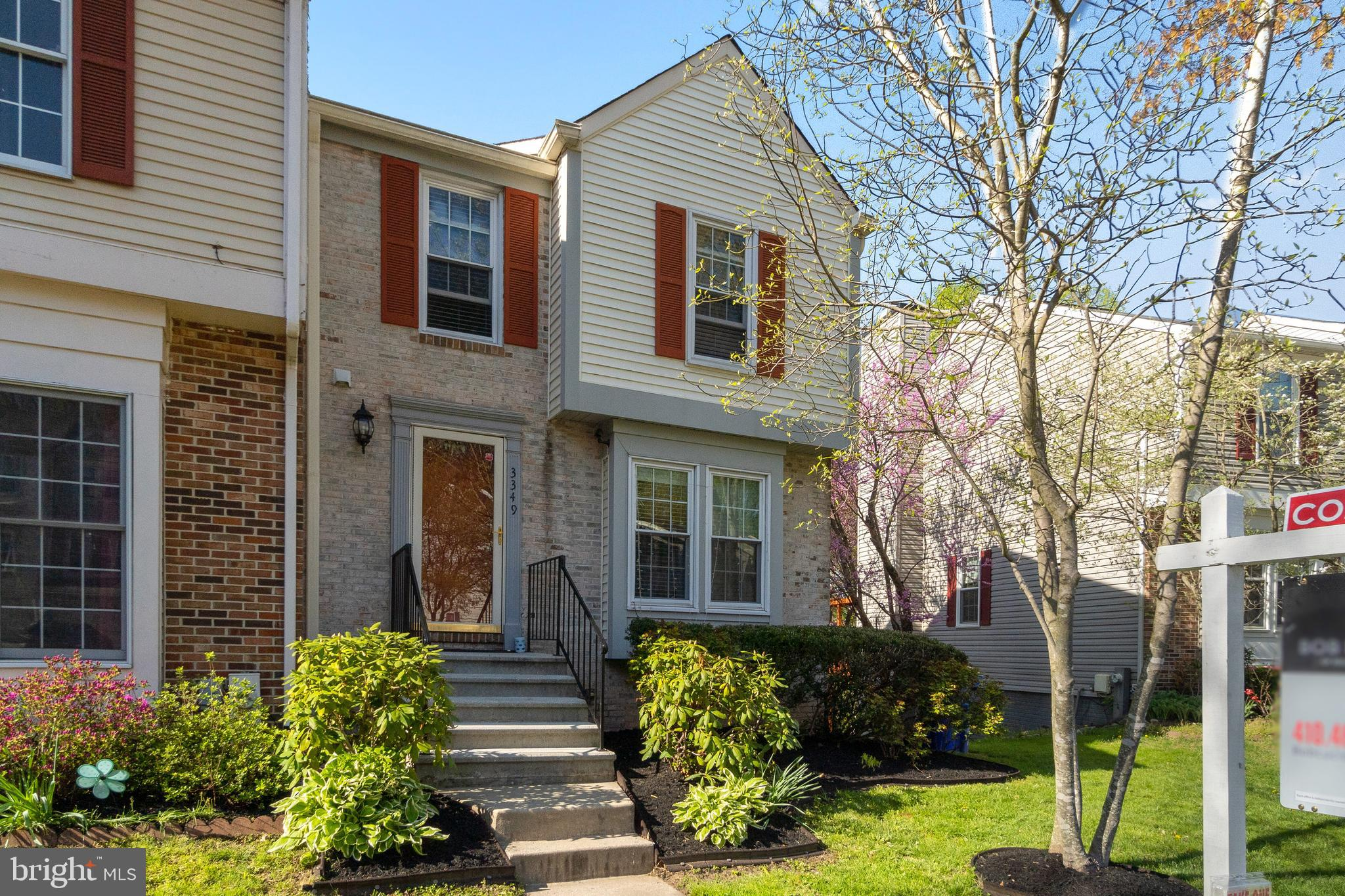 Situated in the sought-after Oak West community is this lovely end-of-group townhome with over 1,320
