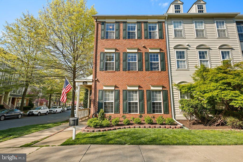 This one is a true beauty. Stunning brick end unit townhouse offers 3 bedrooms and 2.5 baths with 21