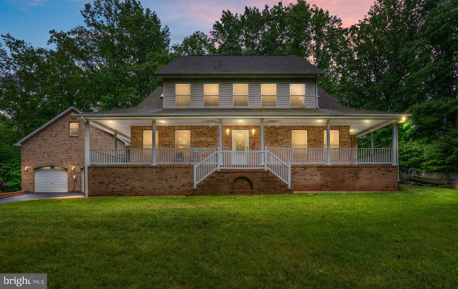 You don't want to miss out on this one of a kind listing! Come check out this custom brick colonial