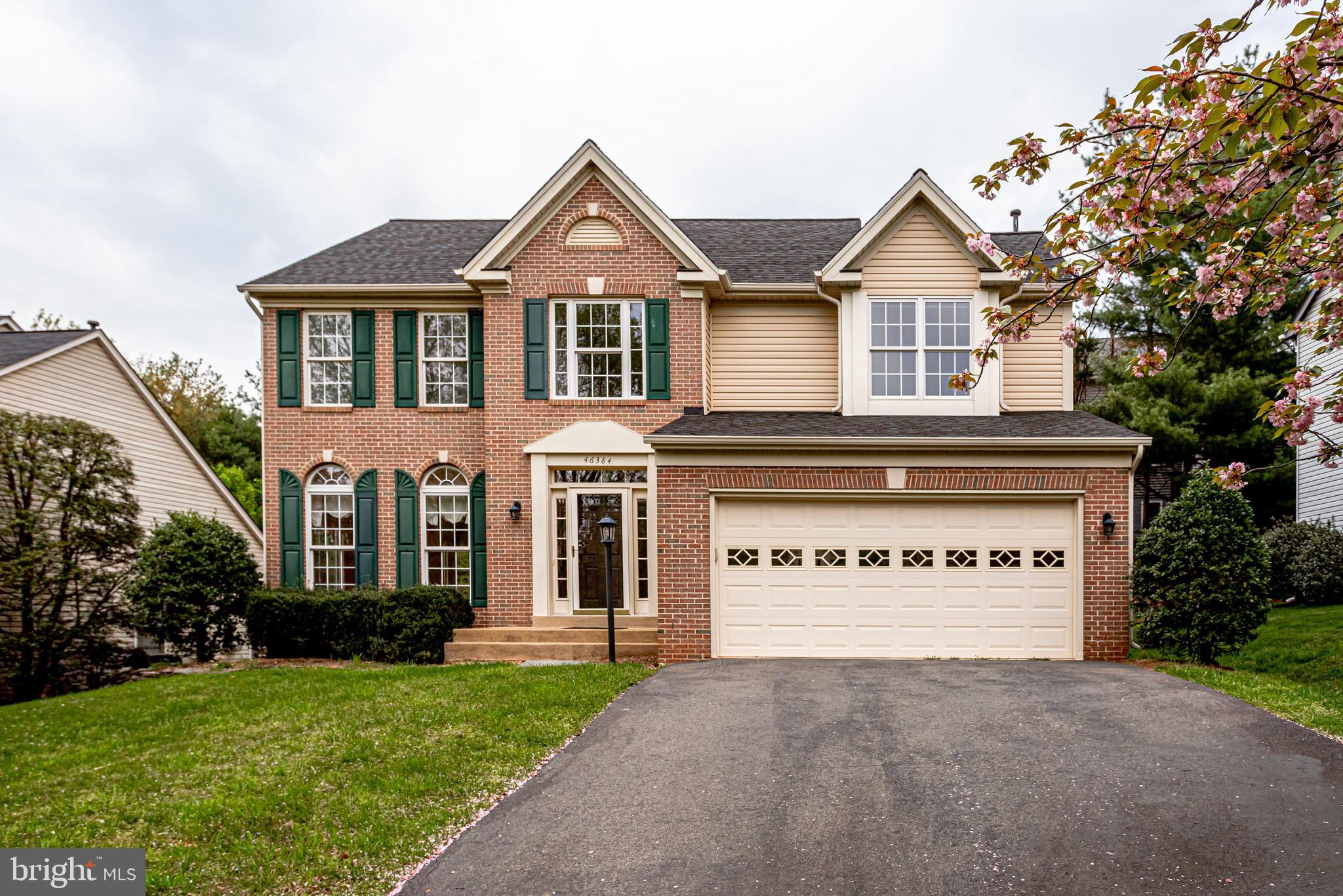 Located on a cul-de-sac in Cascades, this brick front Stanford model built by M/I Homes features upg