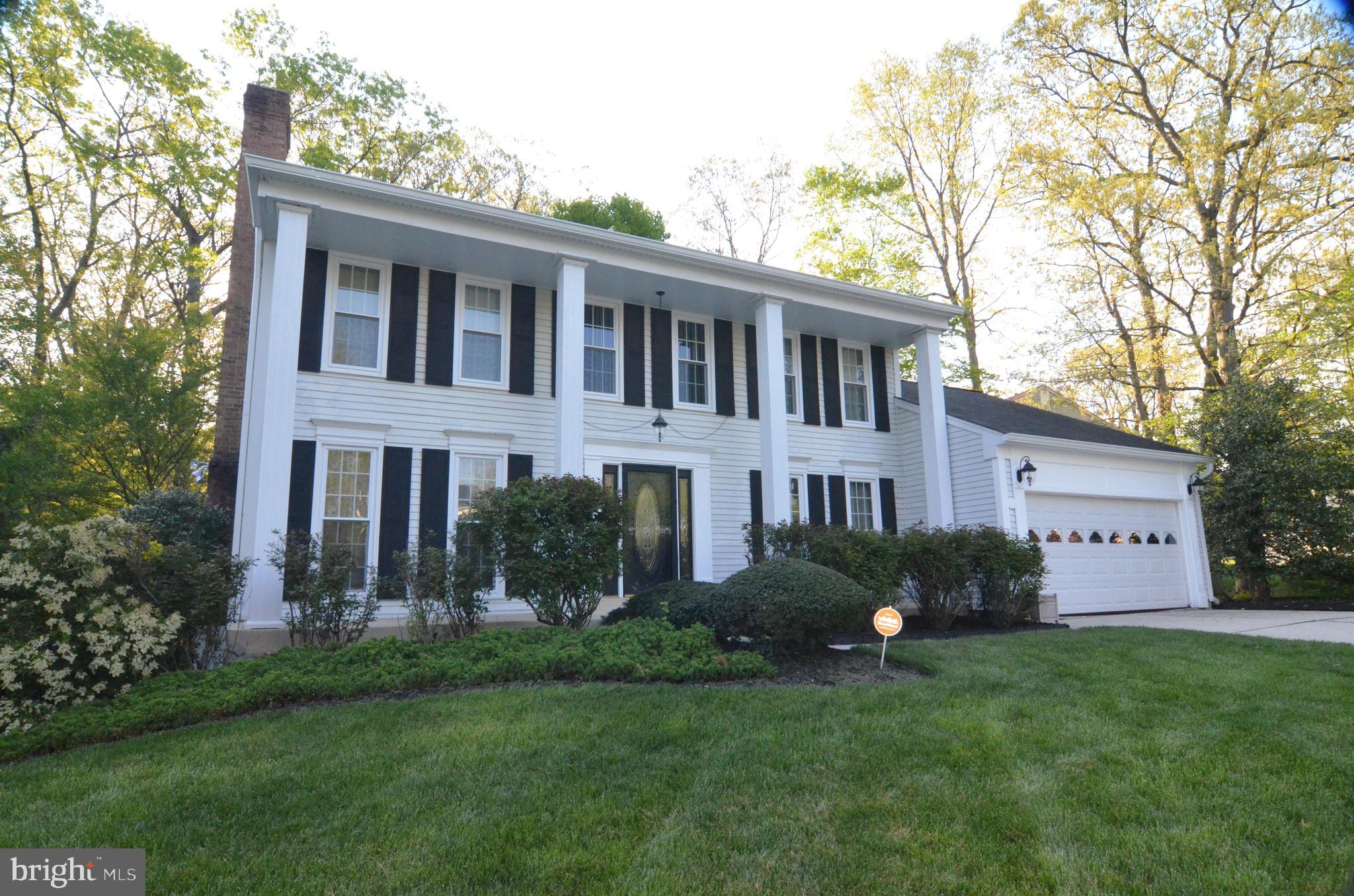 Stately Montpelier Woods colonial located on a beautifully landscaped corner lot backing to wooded p