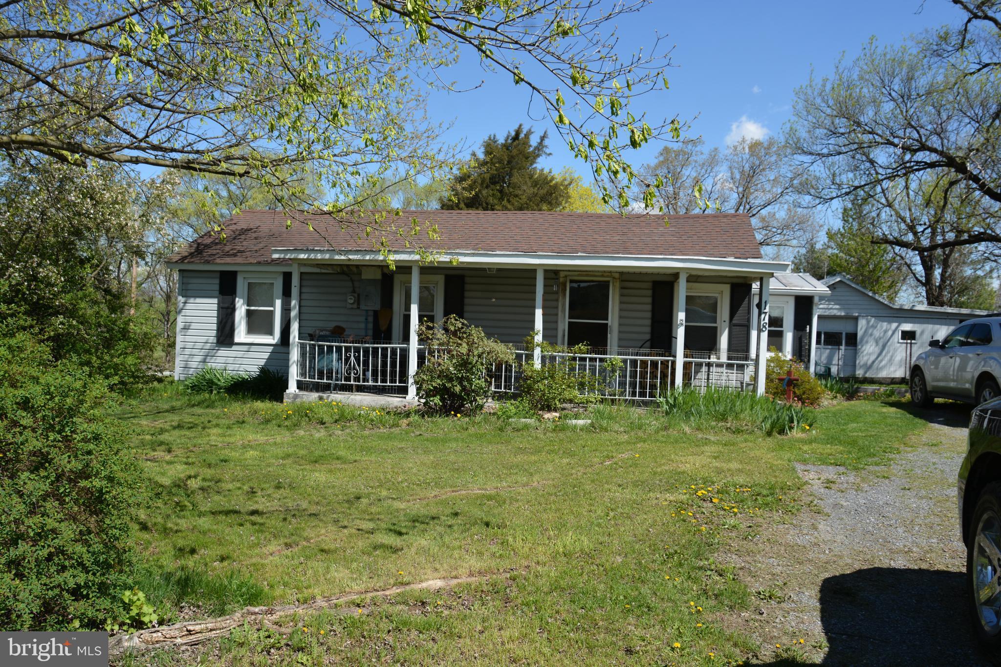 Comfortable bungalow, 3 bedrooms, bath, livingroom w/fireplace, detached garage for possible worksho