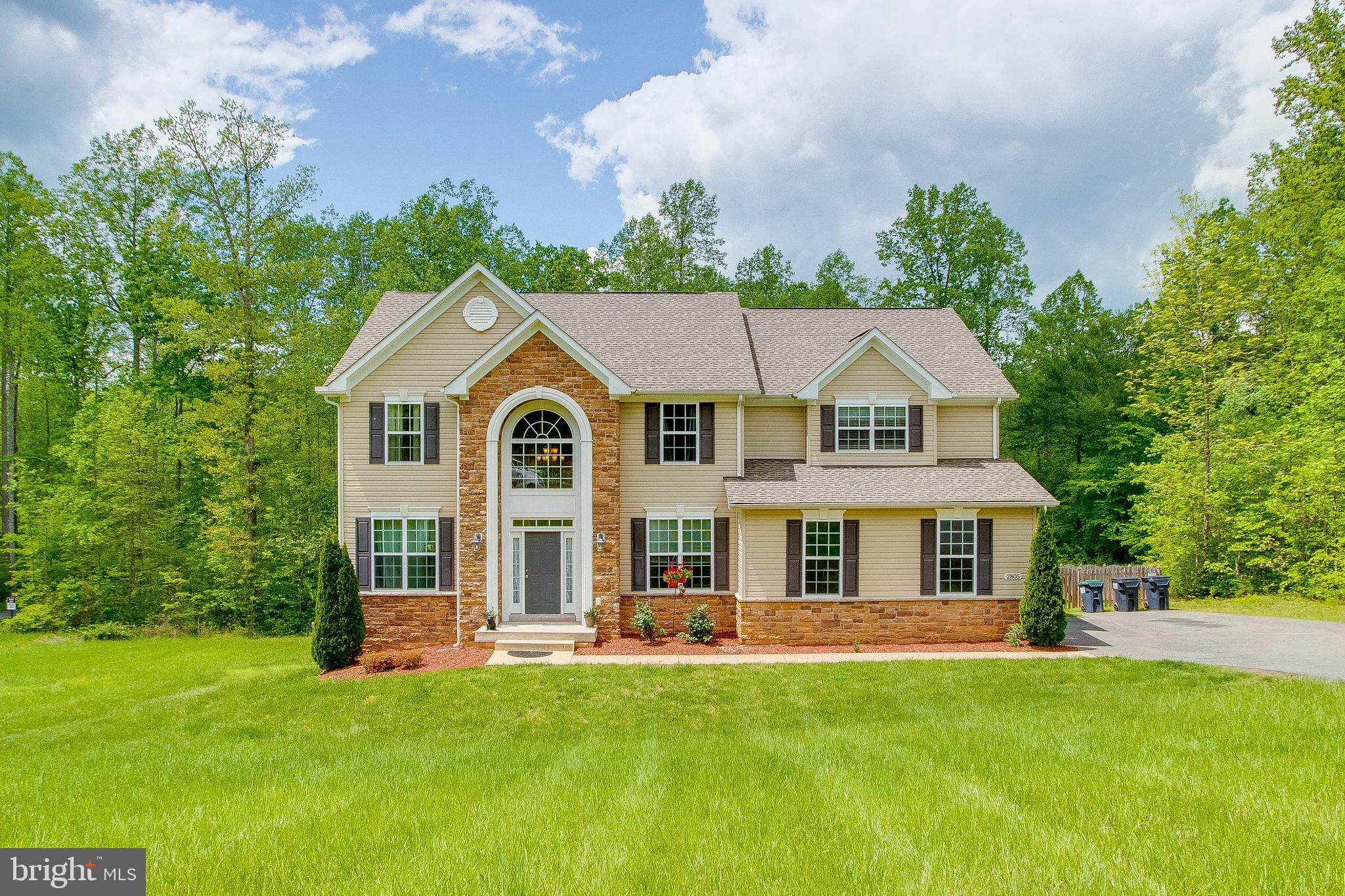 This gorgeous home is ready for you in the Grouse Pointe neighborhood of Stafford.  This premium lot