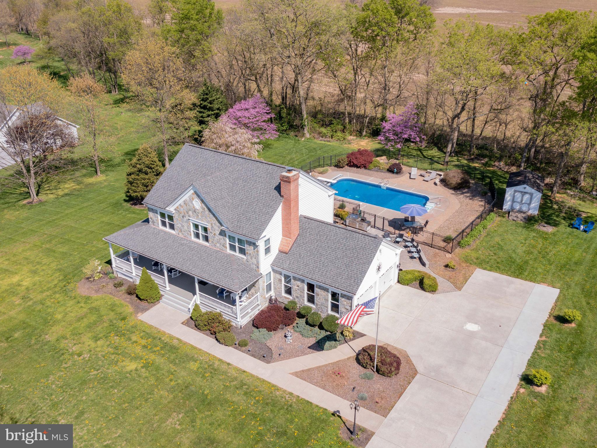 Gorgeous, well-kept home with a saltwater pool, screened in porch, and amazing mountain views! Get e