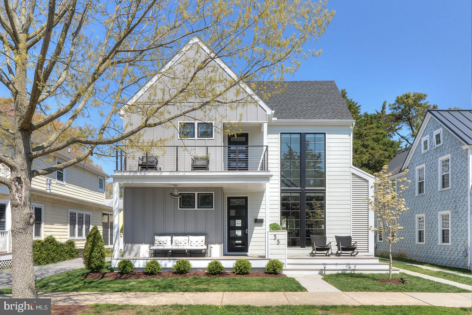 The renovated Maryland Avenue Farmhouse is a luxury home just over a block from the ocean and within