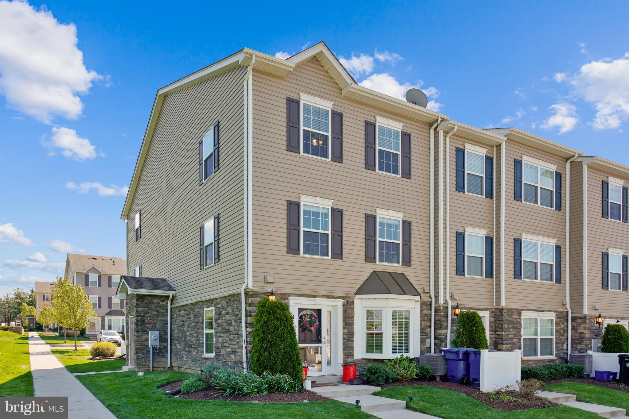 Lovely End Unit Townhome located in a very convenient and sought after neighborhood. Three bedrooms