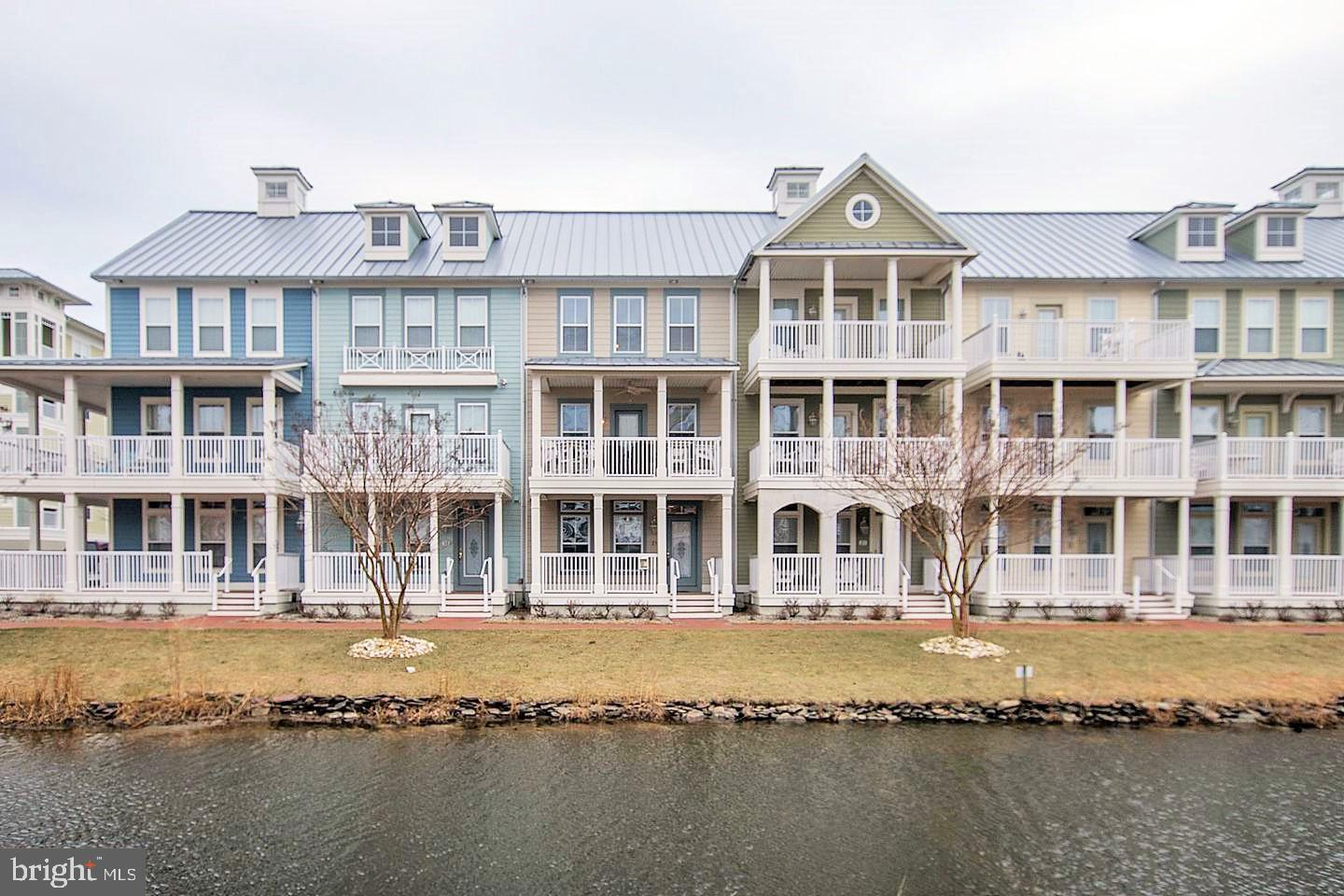 Gorgeous town home tucked away on a serene canal with a partial view of the bay to the north! Spacious open floor plan features a large, fully equipped kitchen, bonus morning room, two dining areas, soaking tub in the master bath, and so much more for your total enjoyment. There is even an outside shower for after a fun day in the sand! Just a short walk to the bay front beaches located on the north side of the island, and less than a 5 minute walk to the indoor/outdoor pools. Sunset Island amenities also include a clubhouse, fitness center, fishing pier, private beaches & walking trails, 24hr. security, interactive fountains, and much more. Sold fully furnished, make it your vacation home or investment property has great rental potential!