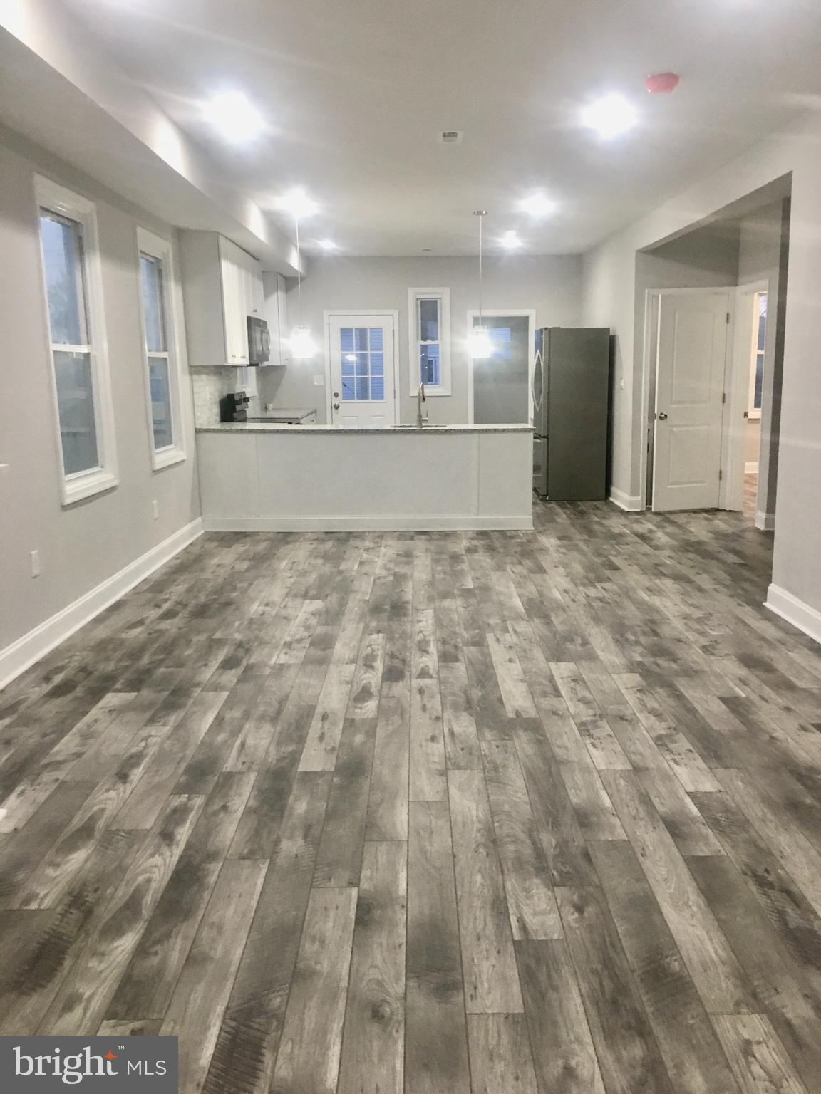 WOW EFFECTS!    (MUST SEE)     Back on the market . Beautiful 6 BR, 4 BH Newly Remodeled.  Spacious, Opened concept main level with 2 BR. Upstairs with 2 masters BR, 2 BH.       Basement 2 BR. (Over 36,000 SF)  =  Largest house in the street. Granite kitchen top & BH. Sun-filled Rooms, Walk-in Closets. Fenced backyard, Deck of the kitchen, Garage. Nice, quiet neighborhood.   Next to Elementary/Mid school. Simply GORGEOUS home you can be Proud of and Enjoy for years to come!