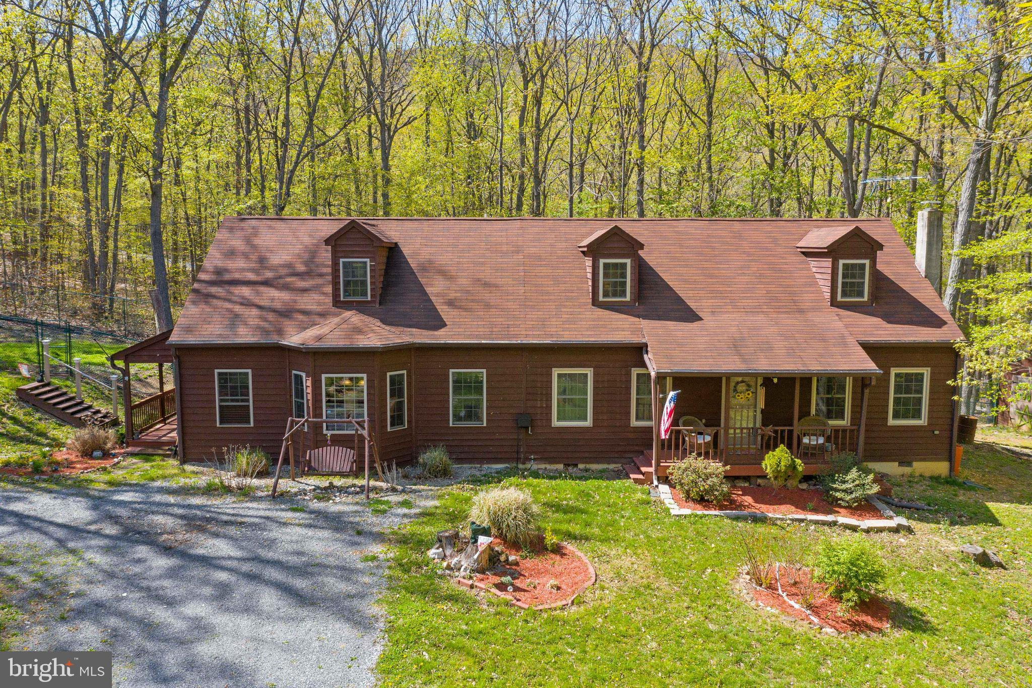 This key-ready Cape Cod is in excellent condition and is situated on a premium double lot, offering