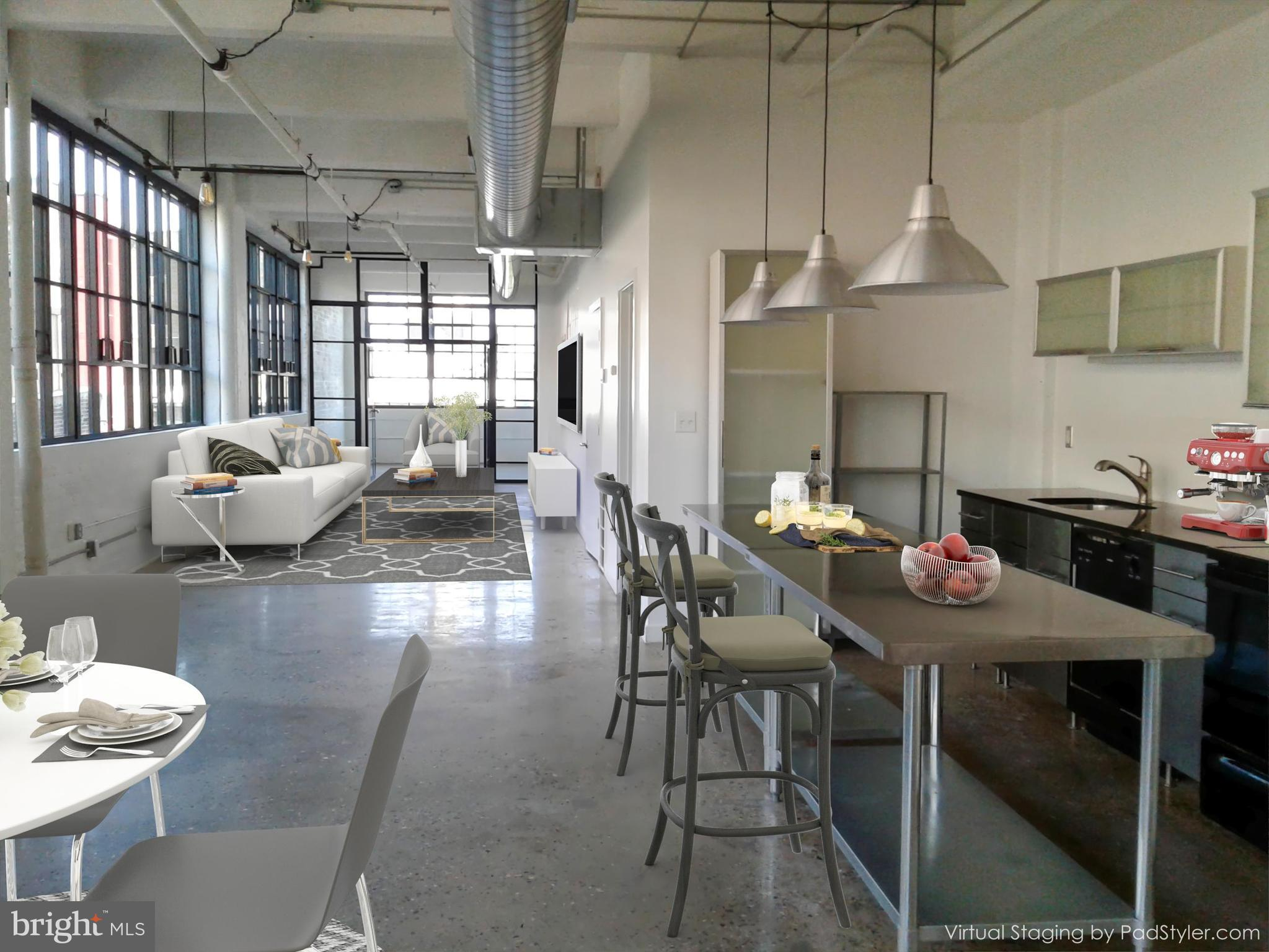 Here's your opportunity to live/work  in a NY Manhattan Style Loft in an Old City Landmark, The Daniel Building. This building is an example of  Art Deco architecture built in 1927 as a garment factory and repurposed  into Live/Work Lofts in 2005.  Views of Old City and Christ Church from East windows. Building includes 14 units and 2 elevators.  Recent renovations include new roof and installation of new unit windows.  Brick pointing and cleaning is being completed. #502 is approx. 2,000 SF of space with 3 sides of full wall  of new windows facing East, West and North forcing light into this awesome unit. This loft features polished concrete floors , high ceilings, open space  Kitchen Stainless cabinets, appliances and granite counters and open dining /living space , 2 bedrooms, 2  full bathrooms and a glass enclosed front room which can be used as a den, library or sitting room.  A Balcony is shared and connects #501 and 502 on the N 3rd Street side. This loft space provides the flexibility of live/work space with Condo Association approval.  Old City has much to offer for those individuals that are looking for a different life style.  Vacant & ready for Occupancy.  Parking is available in the nearby parking lots or garages (prices will vary).