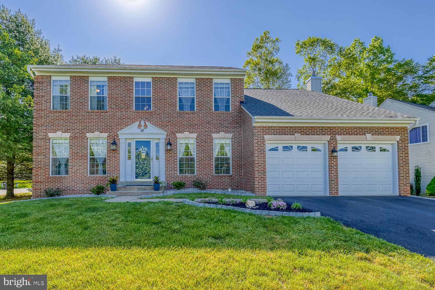 This beautiful brick-front home, situated on a corner lot, shows pride in homeownership. You will no