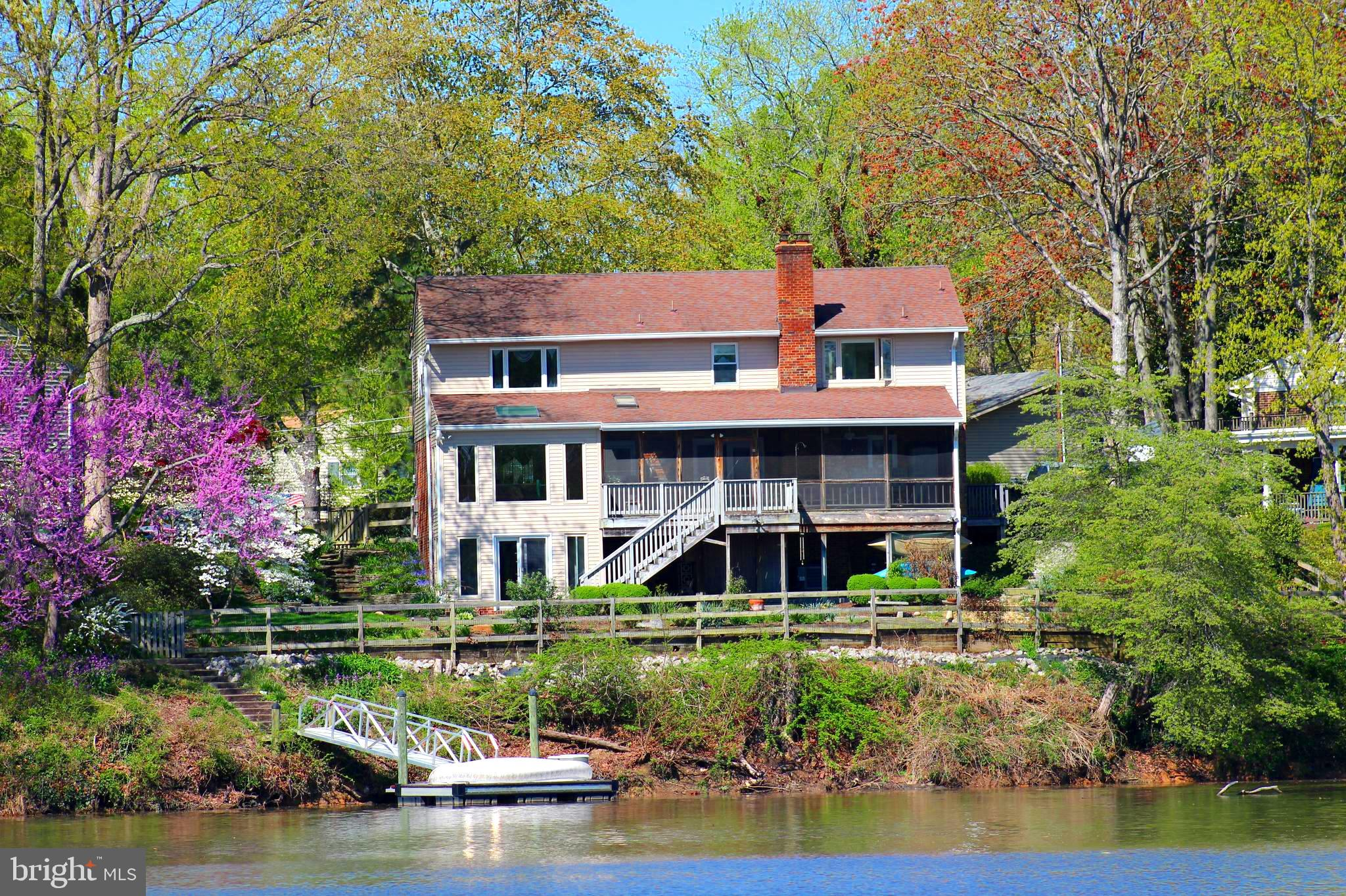 BYO Boat!!  Waterfront  4 BR, 3.5 Bath renovated and expanded  Home with your own Private Floating D